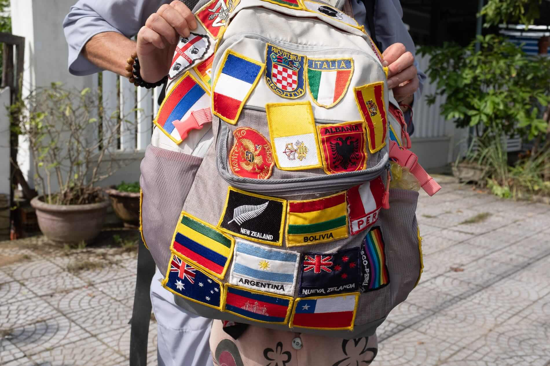 Flags stitched onto a backpackers bag