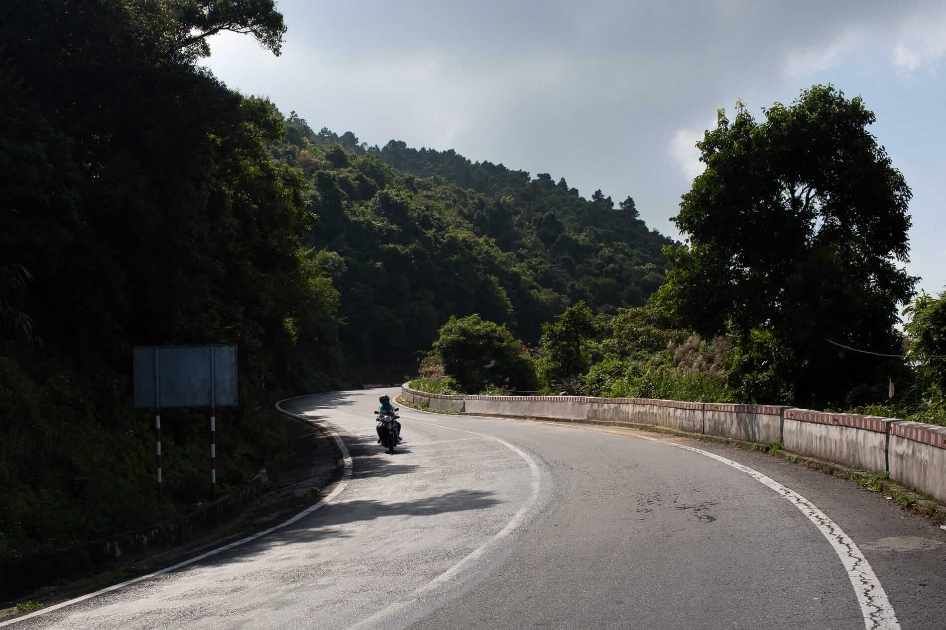 A motorcycle descends the Hai Van Pass