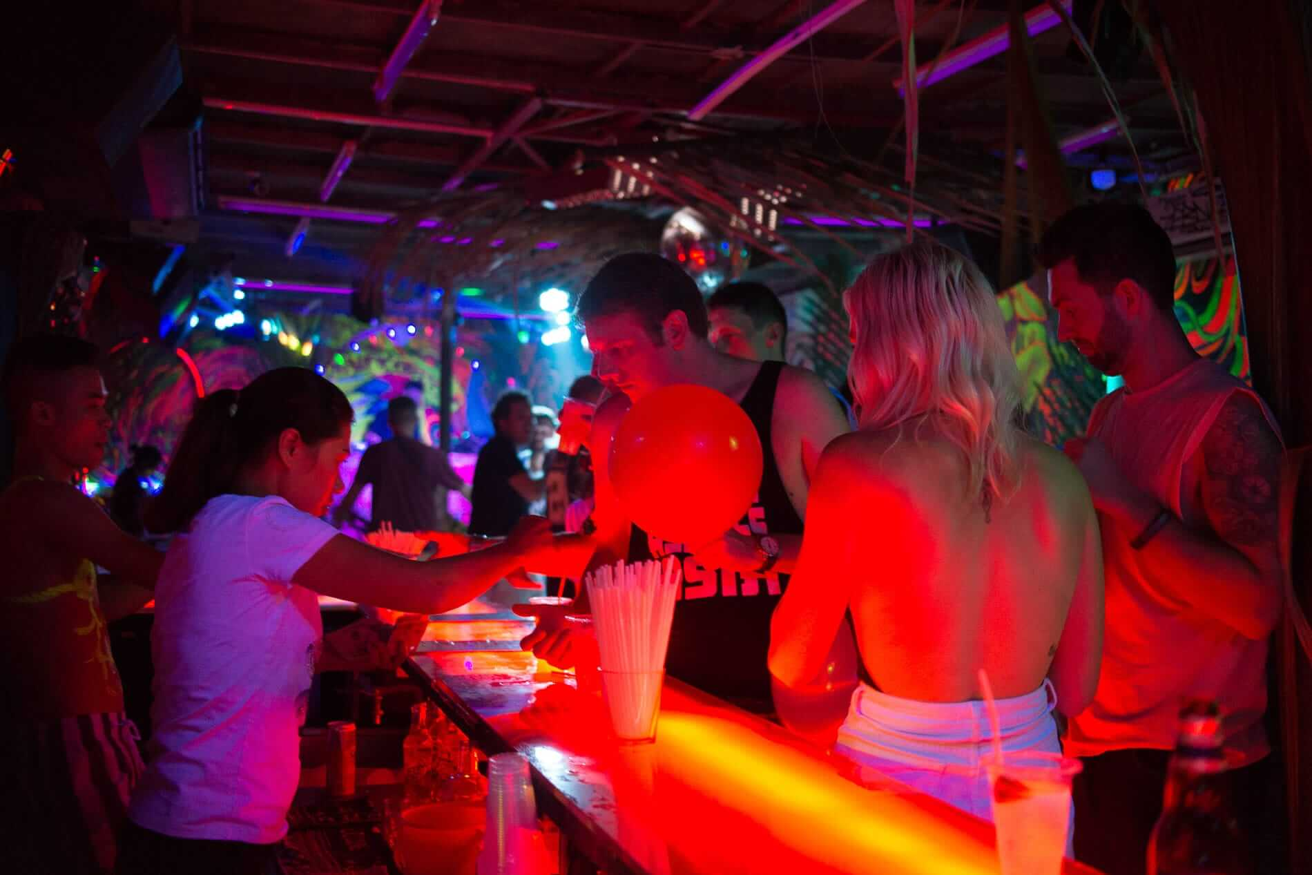 Drinks and party balloons at Hair of the Dog Bar in Hoi An.