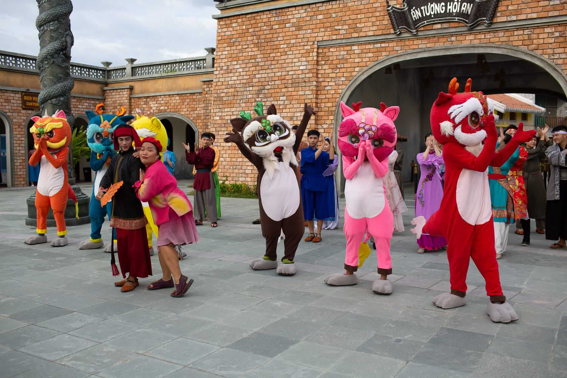 performers at the gates of Impressions Theme Park in Hoi An