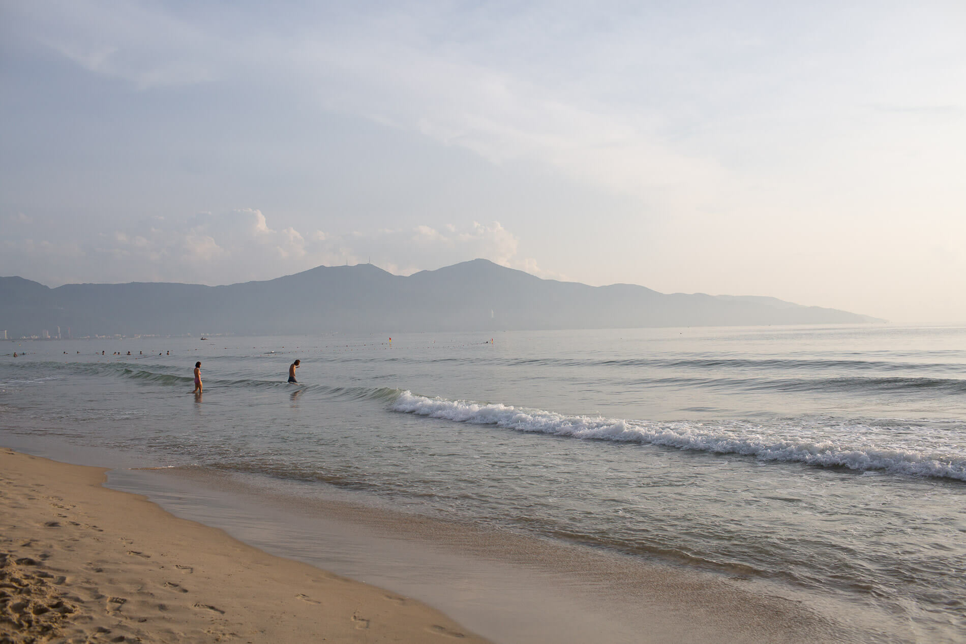 Swimmers on My Khe Beach at dawn