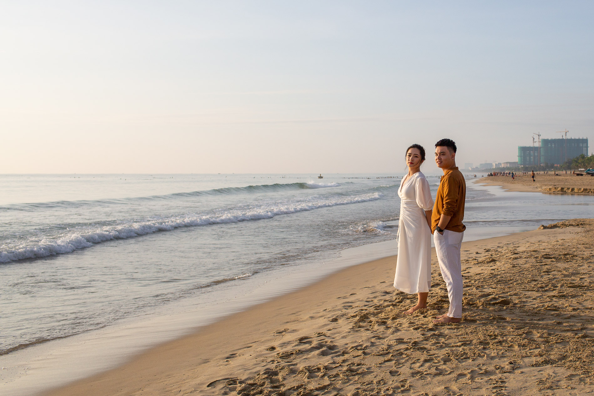 a Vietnamese couple pose at My Khe Beach