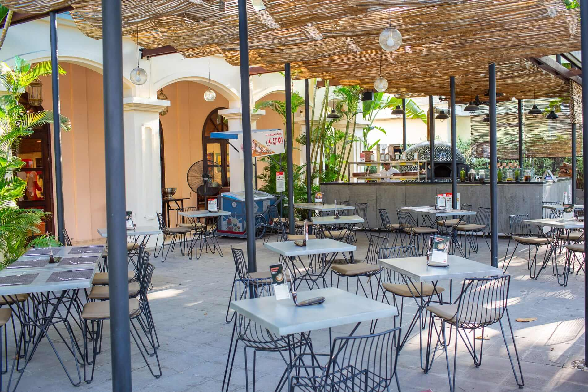 outdoor dining area and pizza oven at Art Space in Hoi An