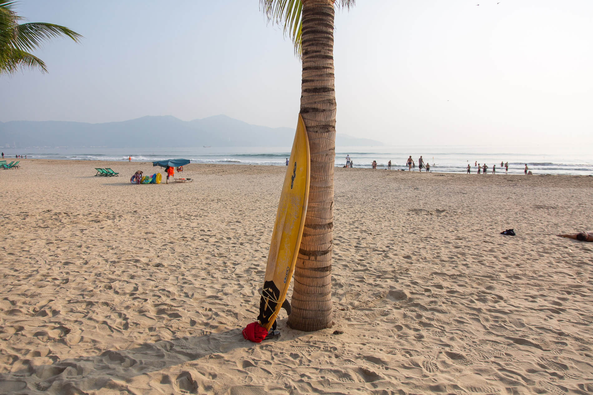 Surfboards, palm trees and wide sandy beaches of Da Nang