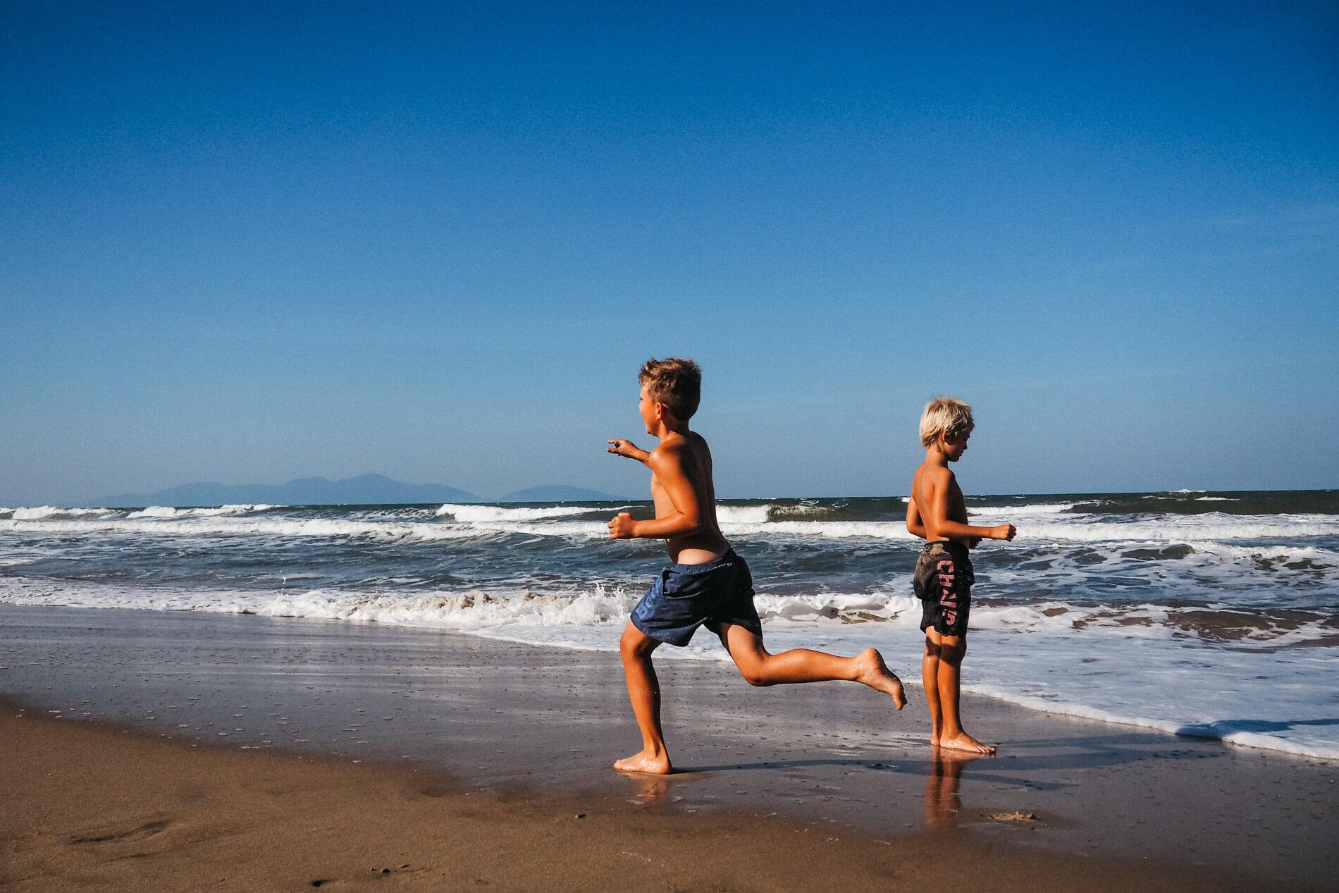 boys play in the surf along Da Nang's beach