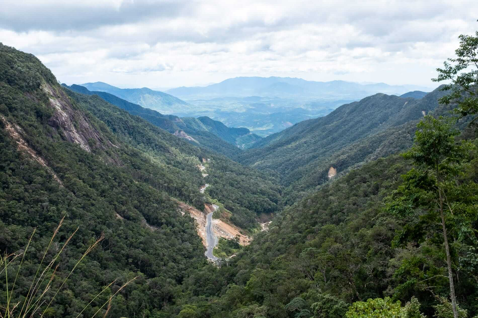 A road winds up the mountains into Da Lat City