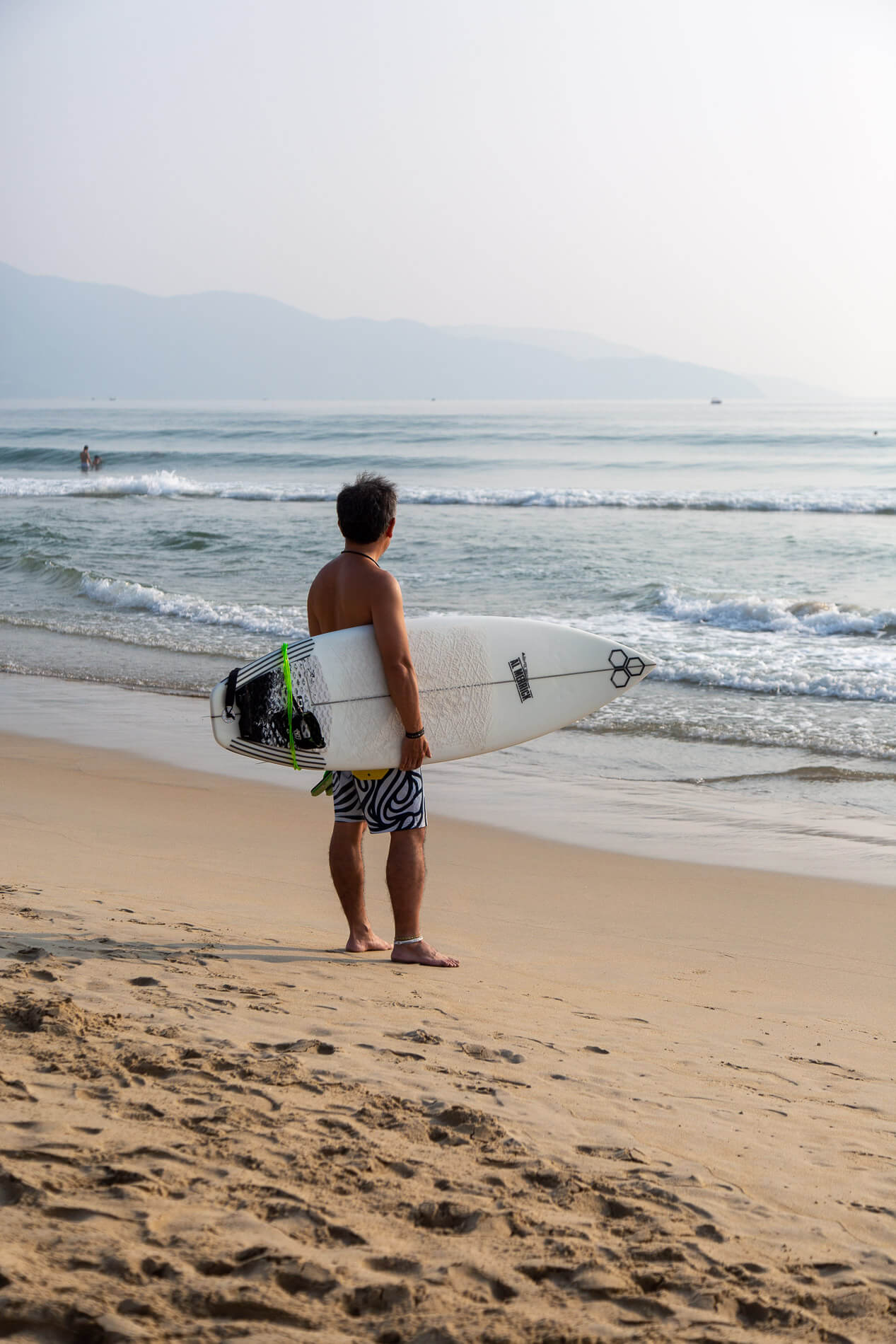 a surfer in Da Nang