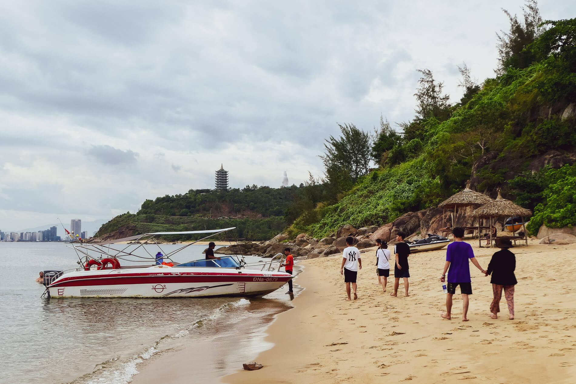 a speedboat brings beach goers to Bai Rang beach Da Nang