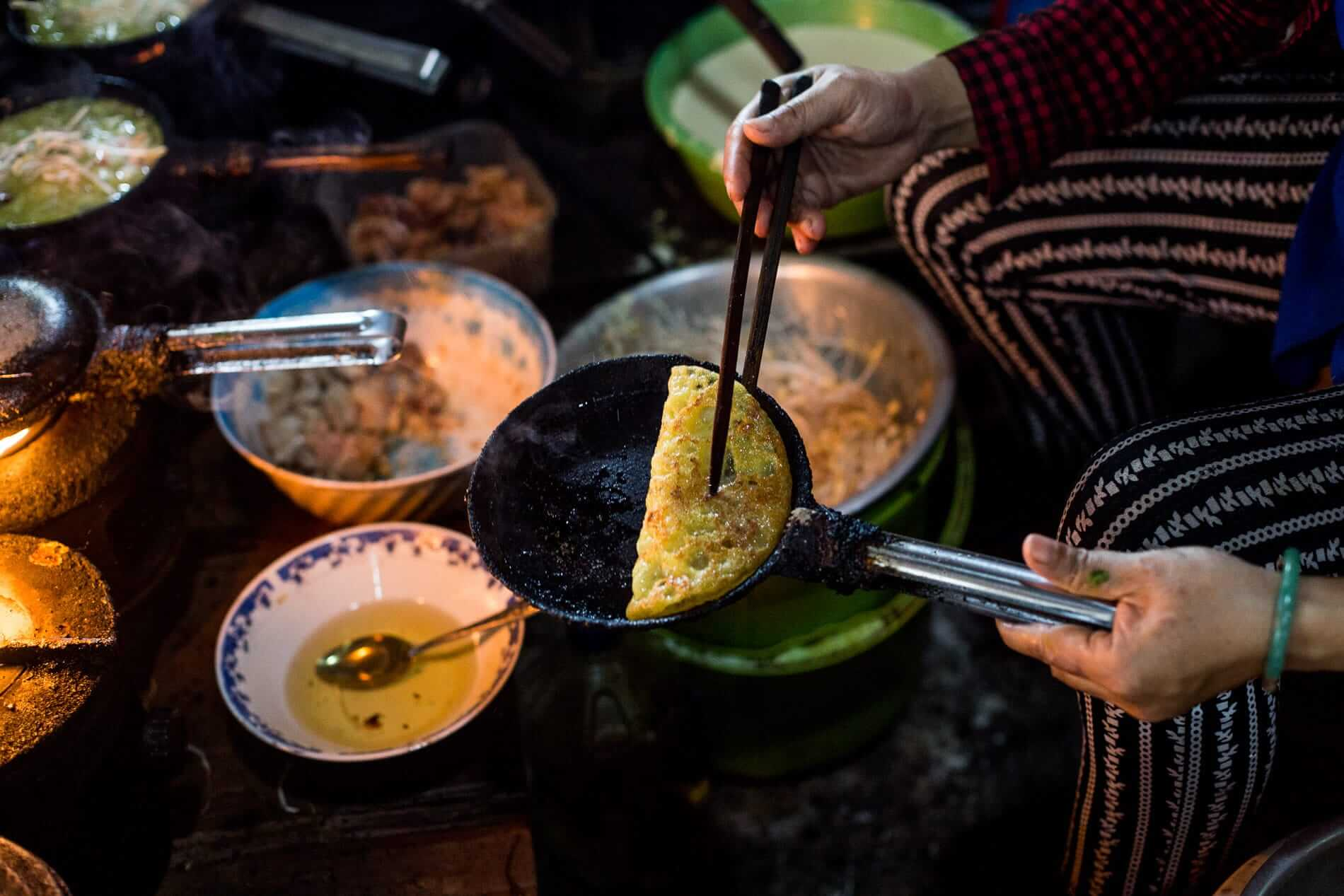 Banh Xeo is cooked at a market stall