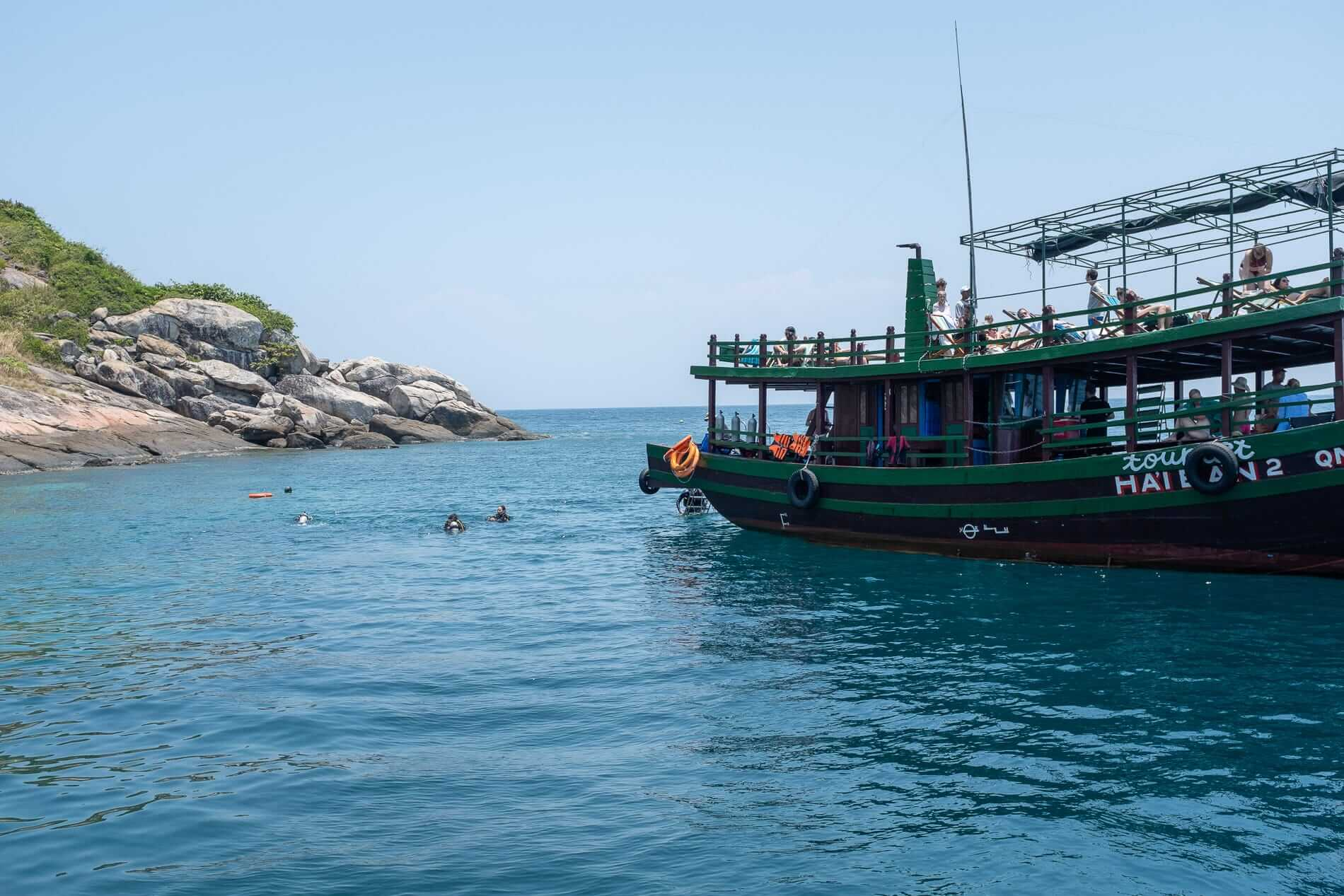 Cham Islands divers and students on a boat