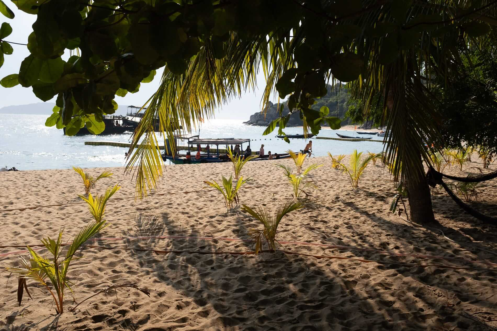 Dive boats anchored off the beach of Cham islands