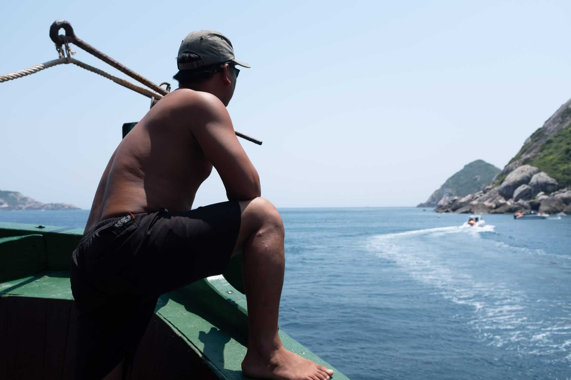 Crew watch over the divers on a trip to scuba dive the Cham Islands