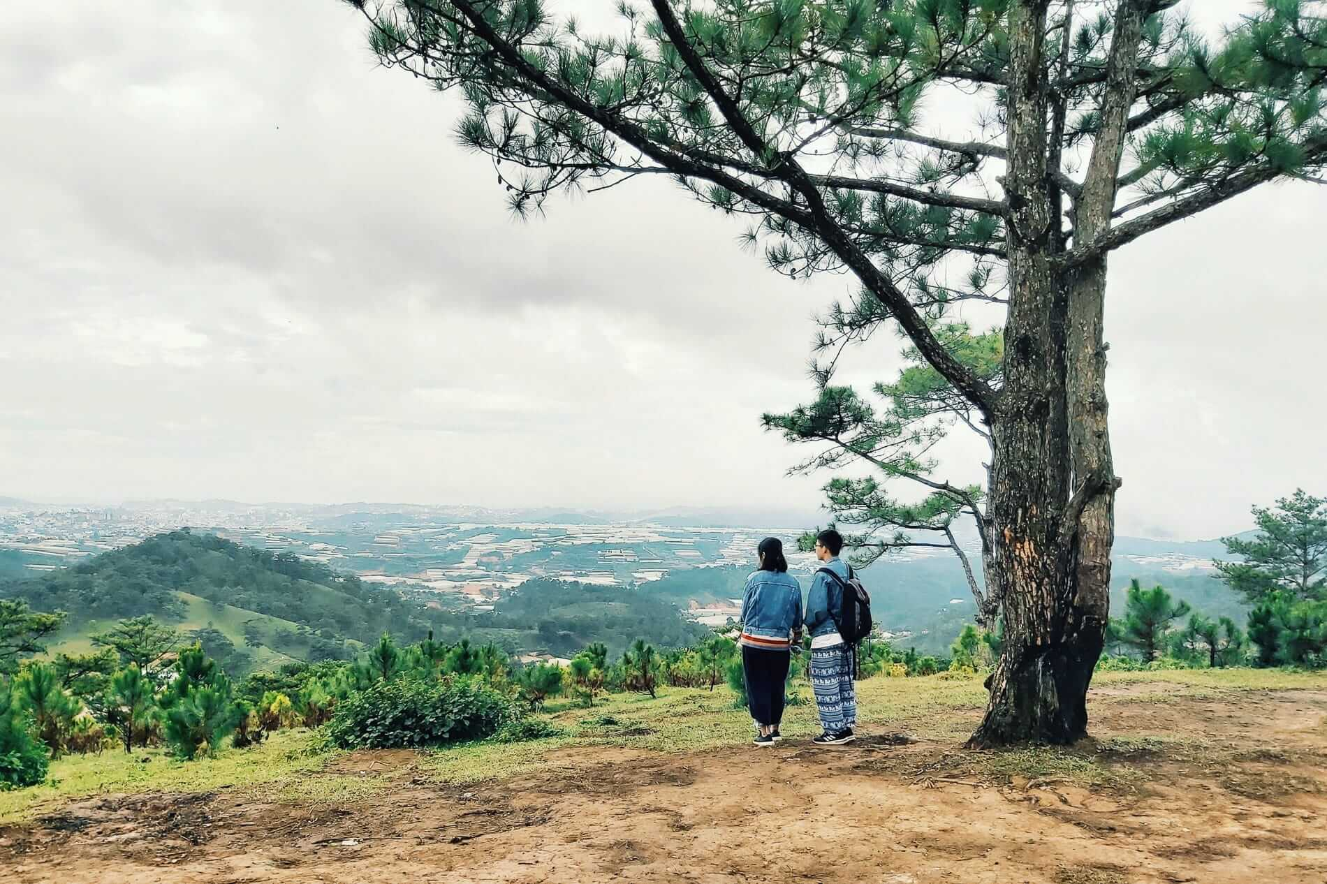 visitors enjoy this mountainside view of Da Lat City