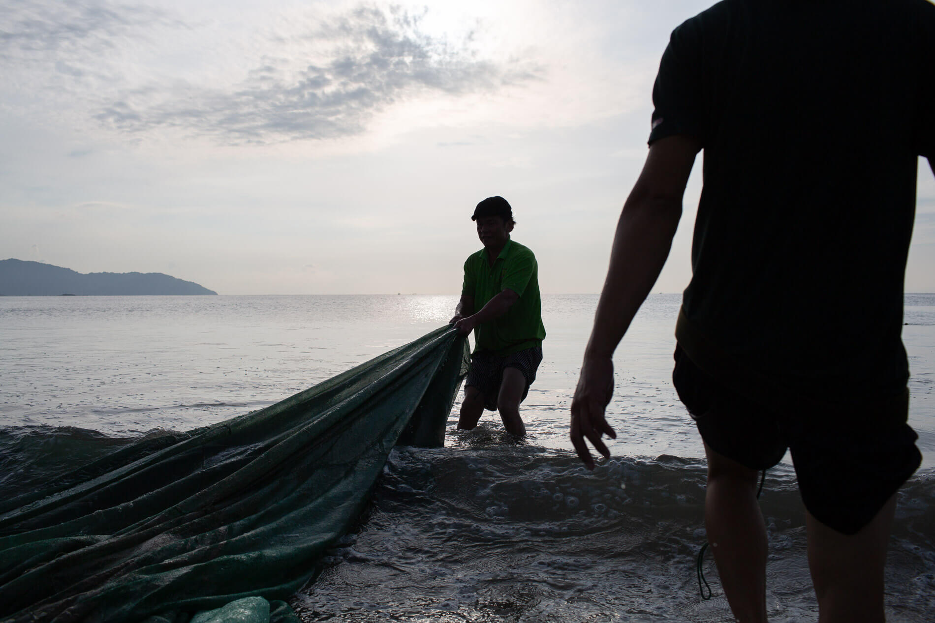 Fishermen pull in their nets along Da Nang's Man Thai beach