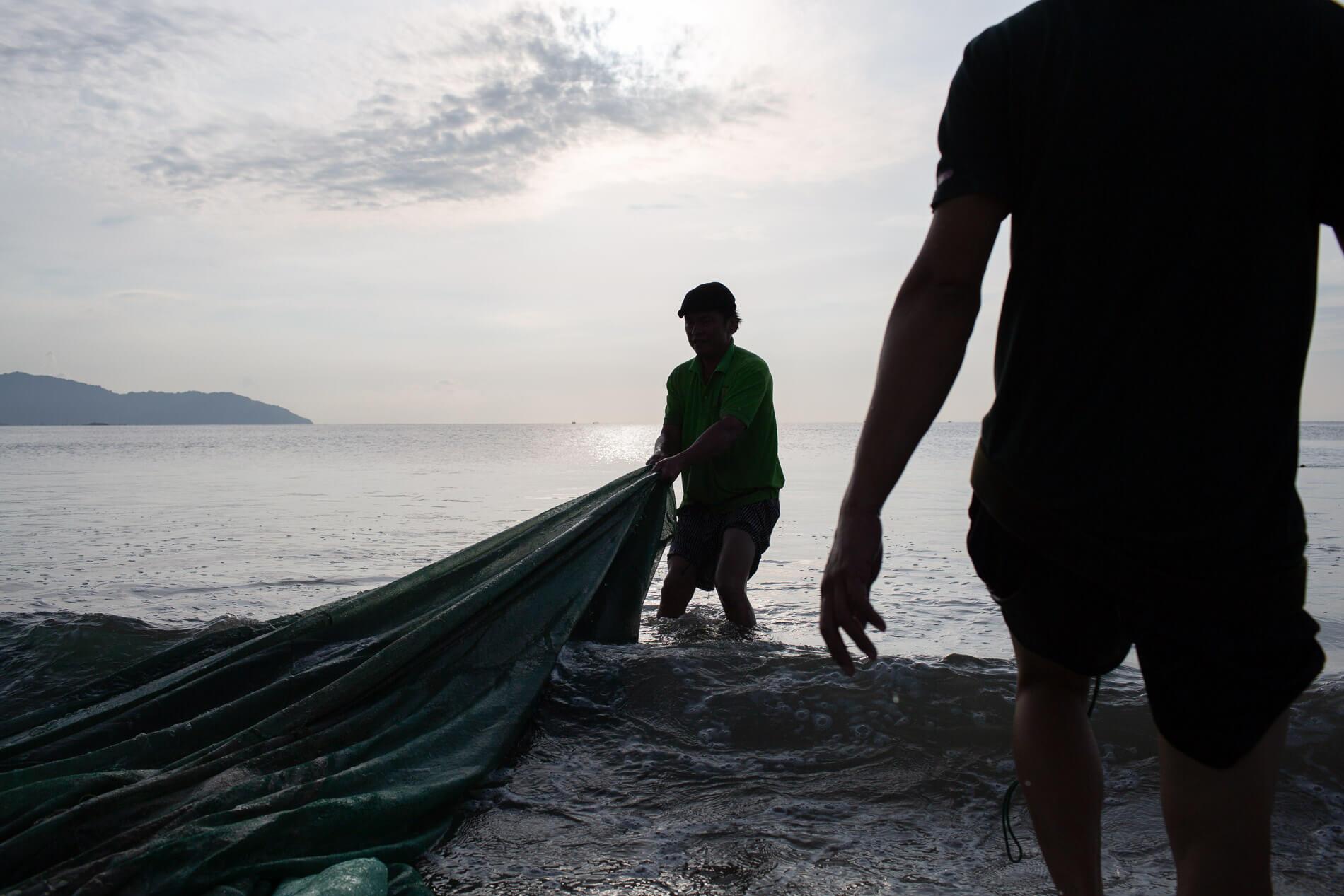 Fishermen pull in their nets along Da Nang's Man Thai beach