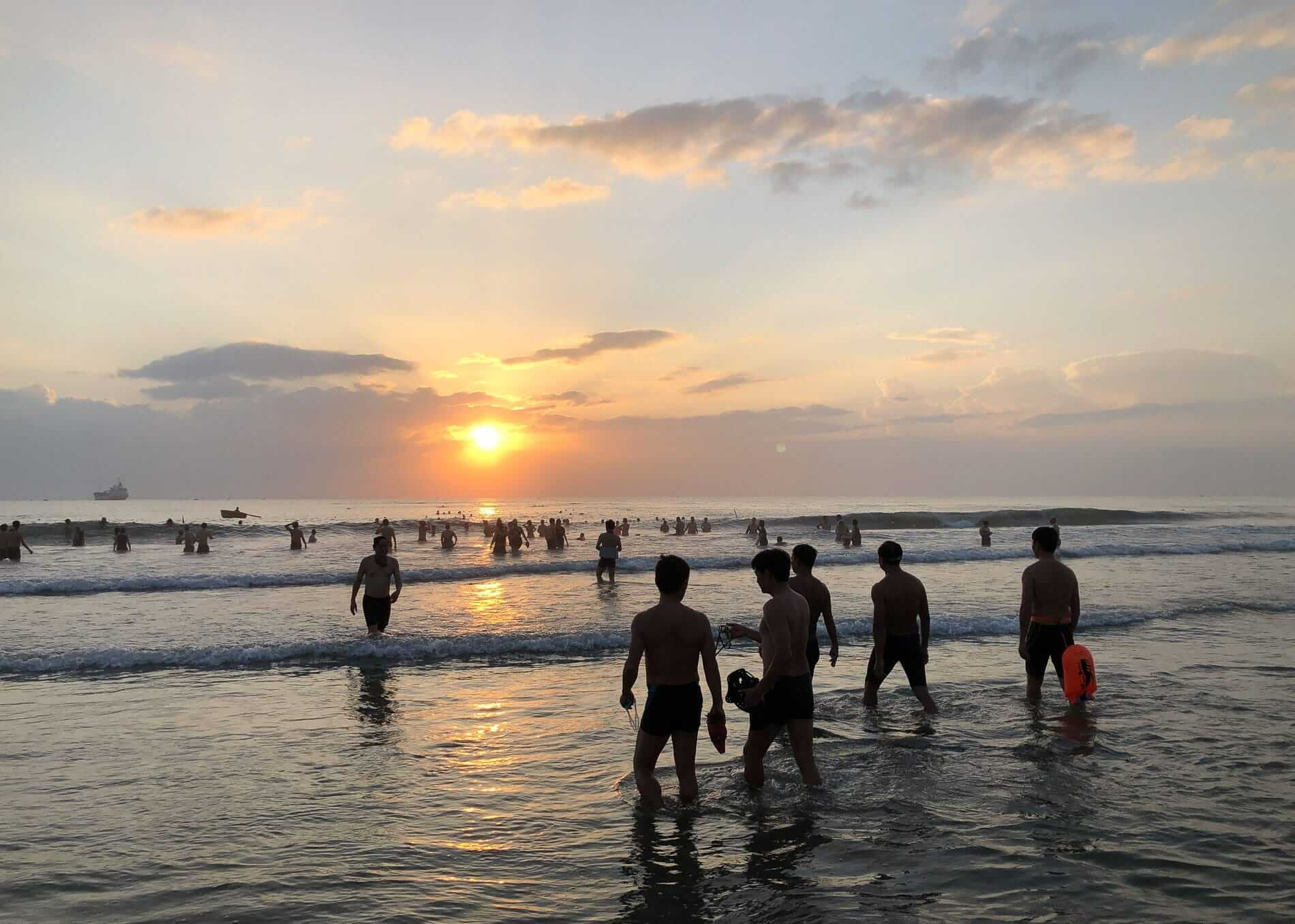 swimmers at sunset