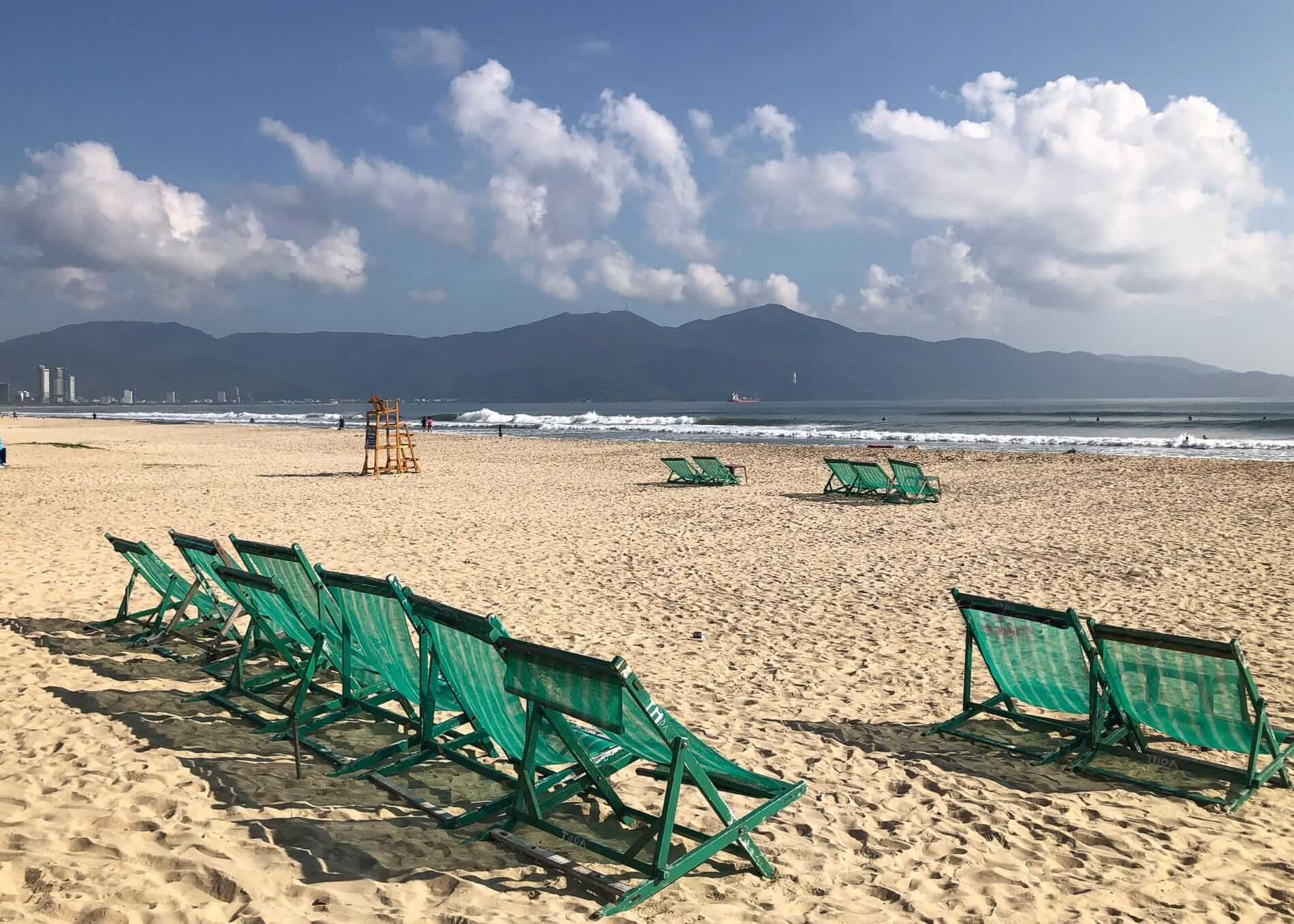 green beach chairs lined at My Khe Beach