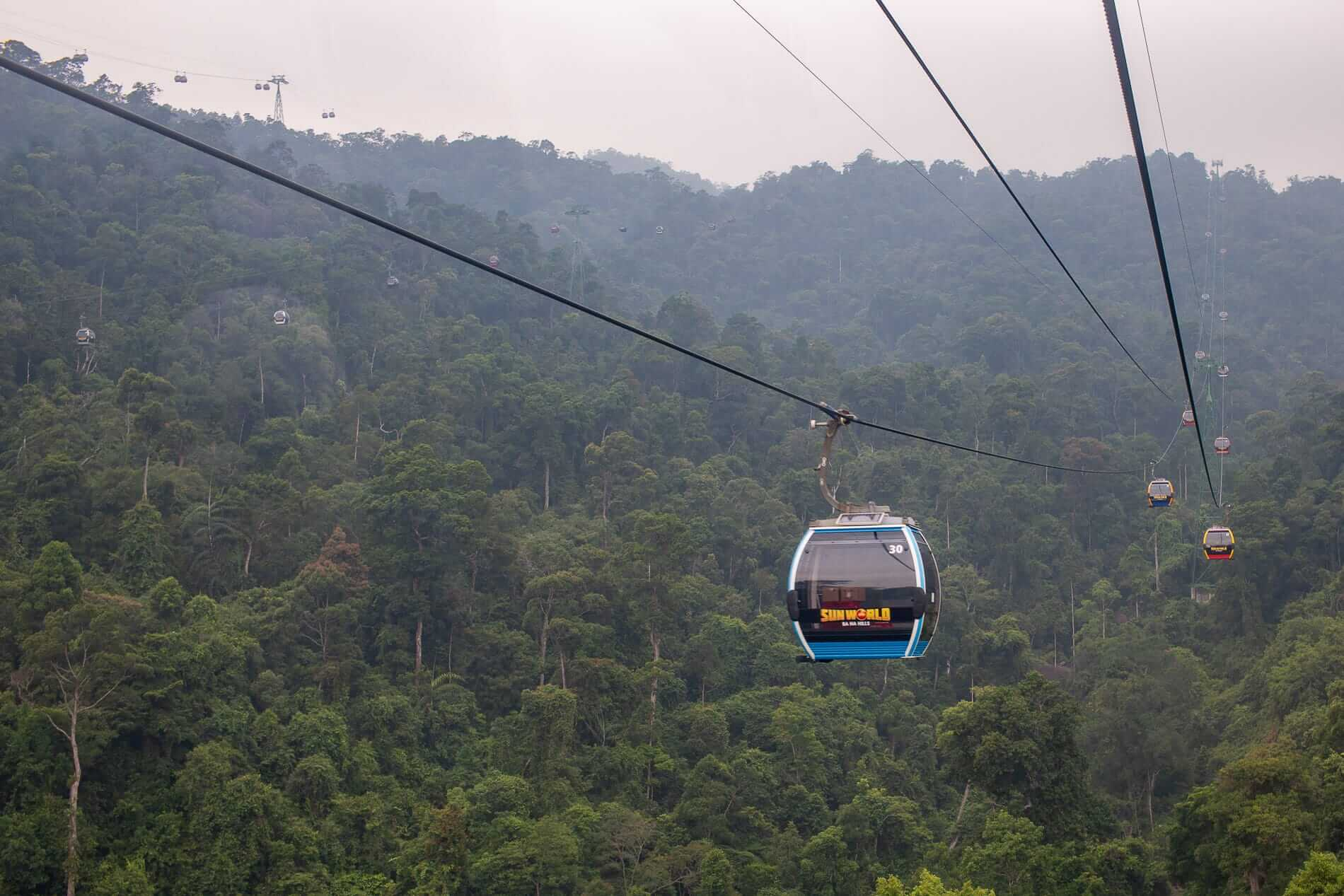 Ba Na hills cable car as it passes the hill