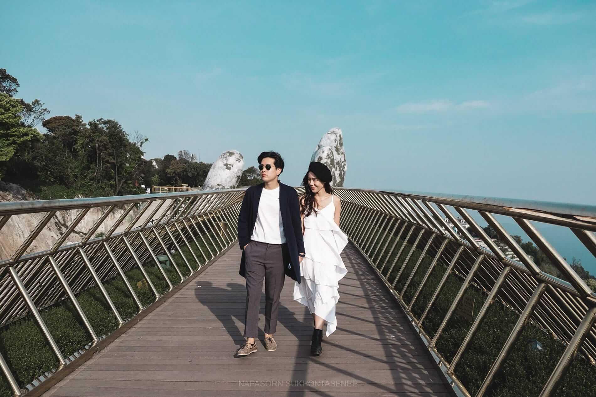 A couple walks Golden Hand Bridge