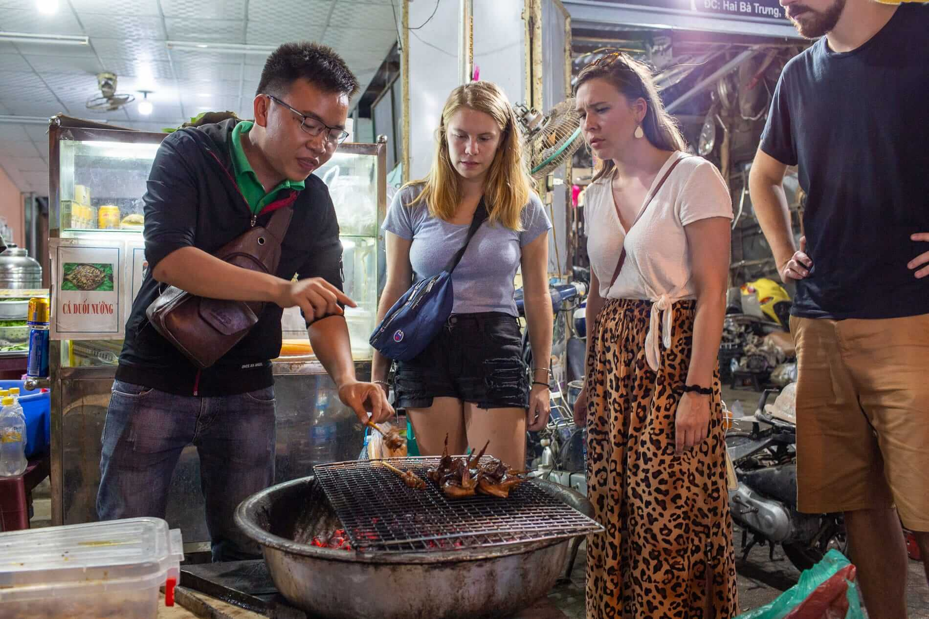 tour guide explaining how to cook a local dish
