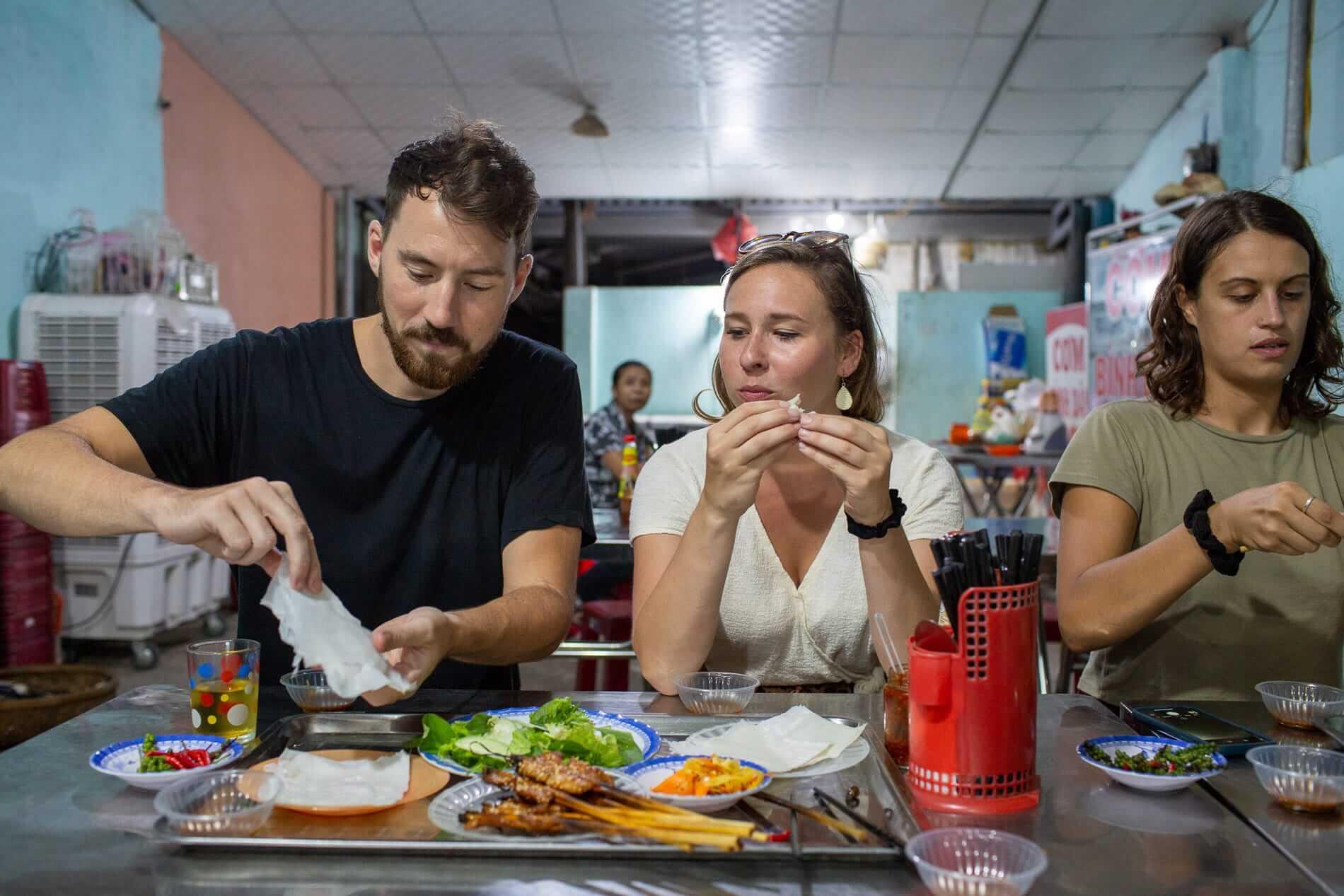 the Hidden enjoys the food on tour in Hoi An