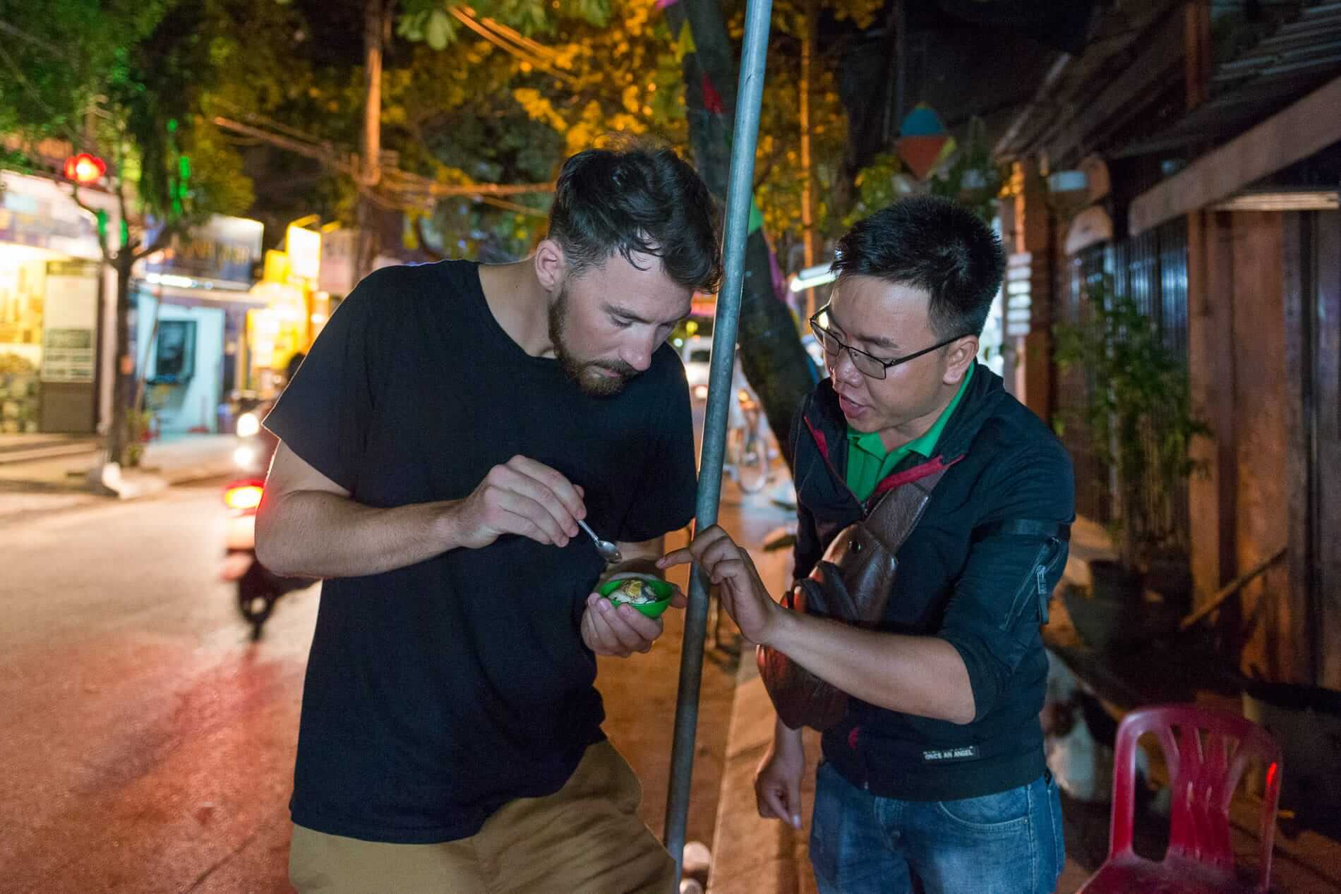 eating local street food on a tour in Hoi An