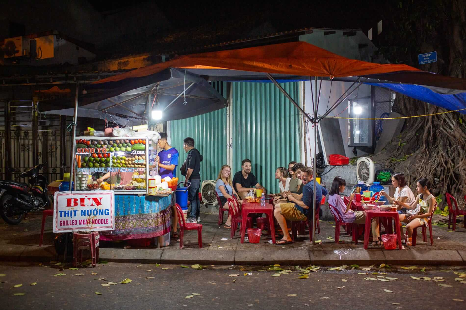 travelers in Hoi An enjoying the food tour at night