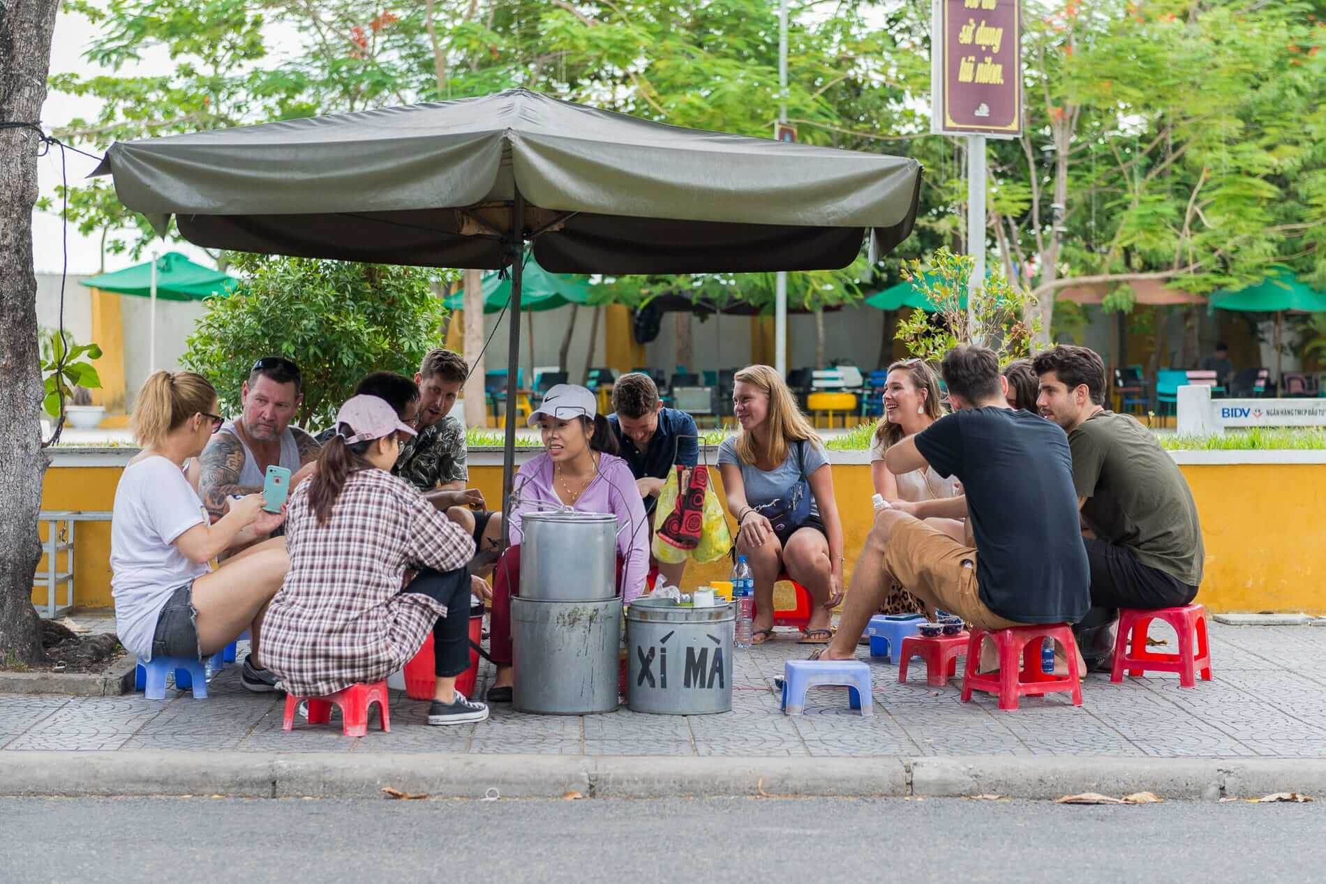 travellers meet at a food stall