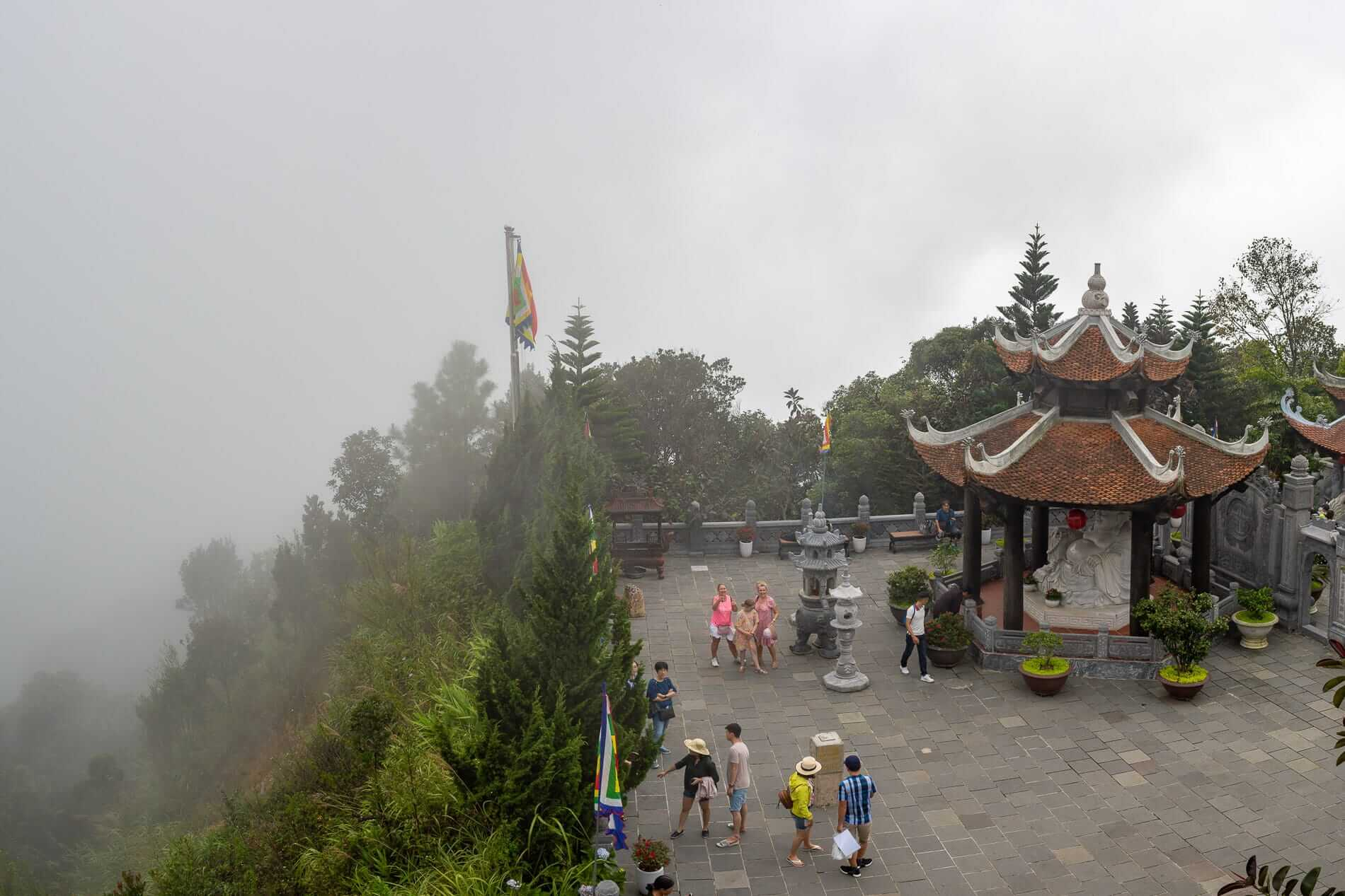 Temple and tourists on a foggy day