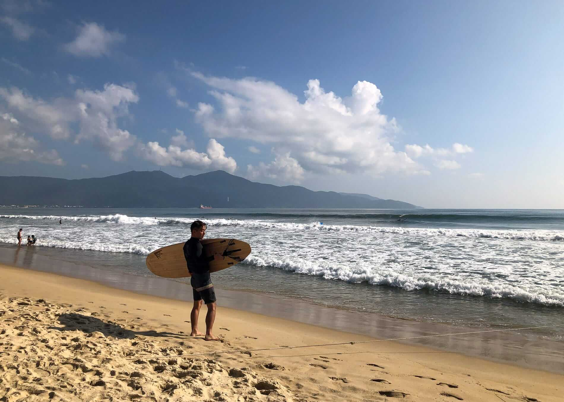 a surfer prepares to go surfing