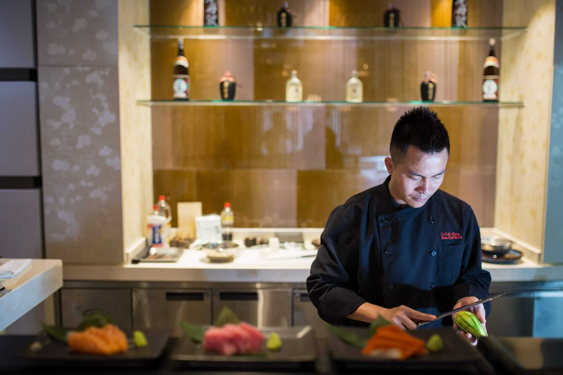 A chef at Wakaku restaurant prepares a meal