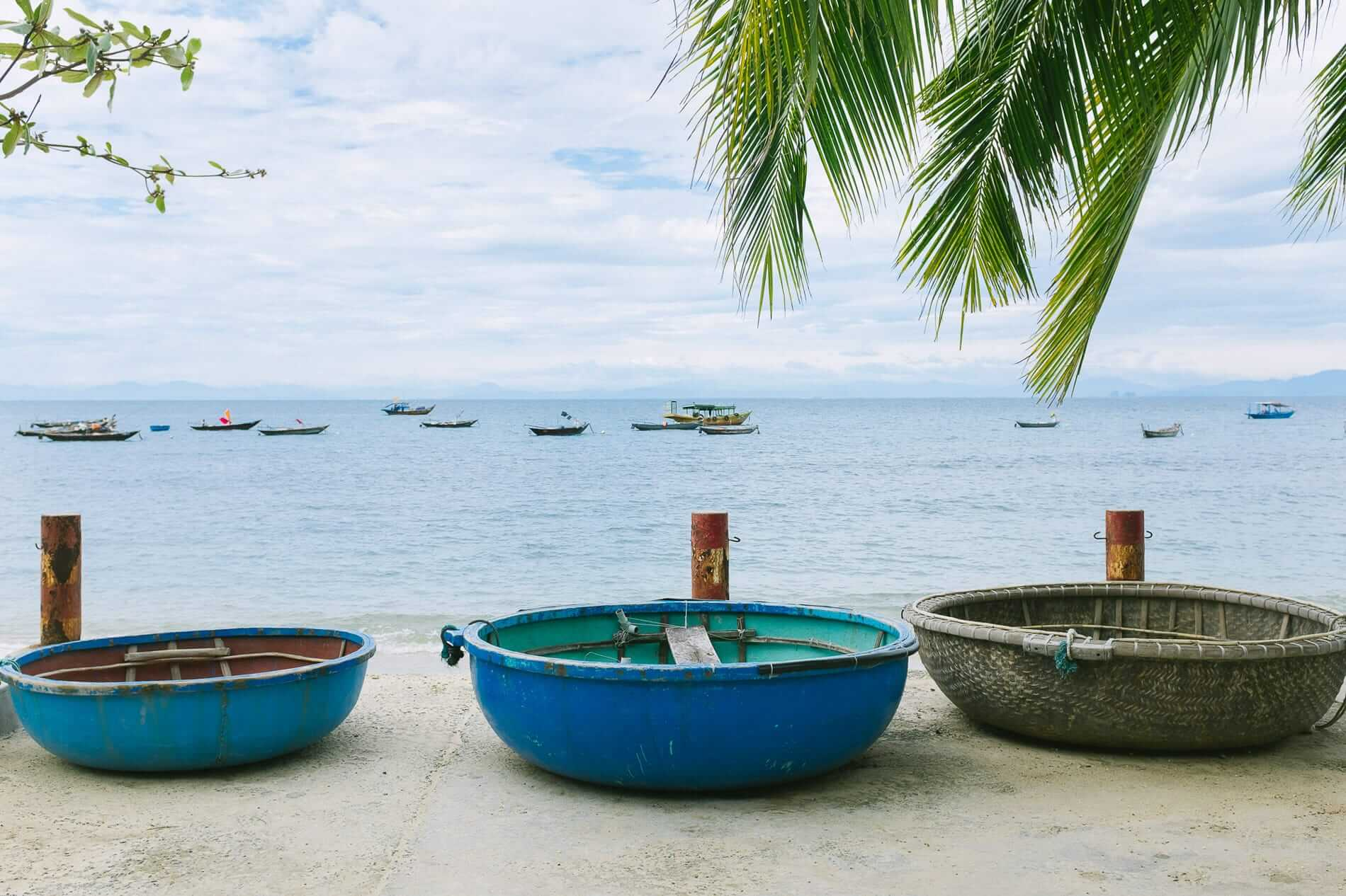 Conical boats on a calm day at Cham Islands