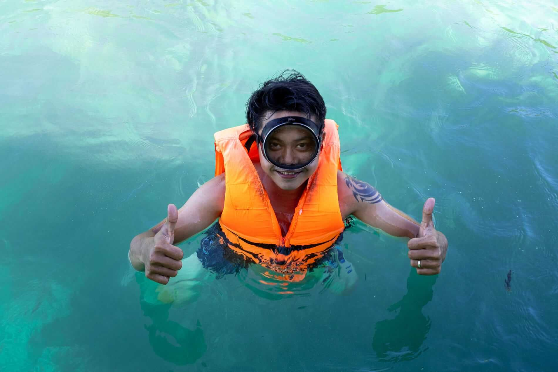 A satisfied swimmer while snorkelling in Hoi An