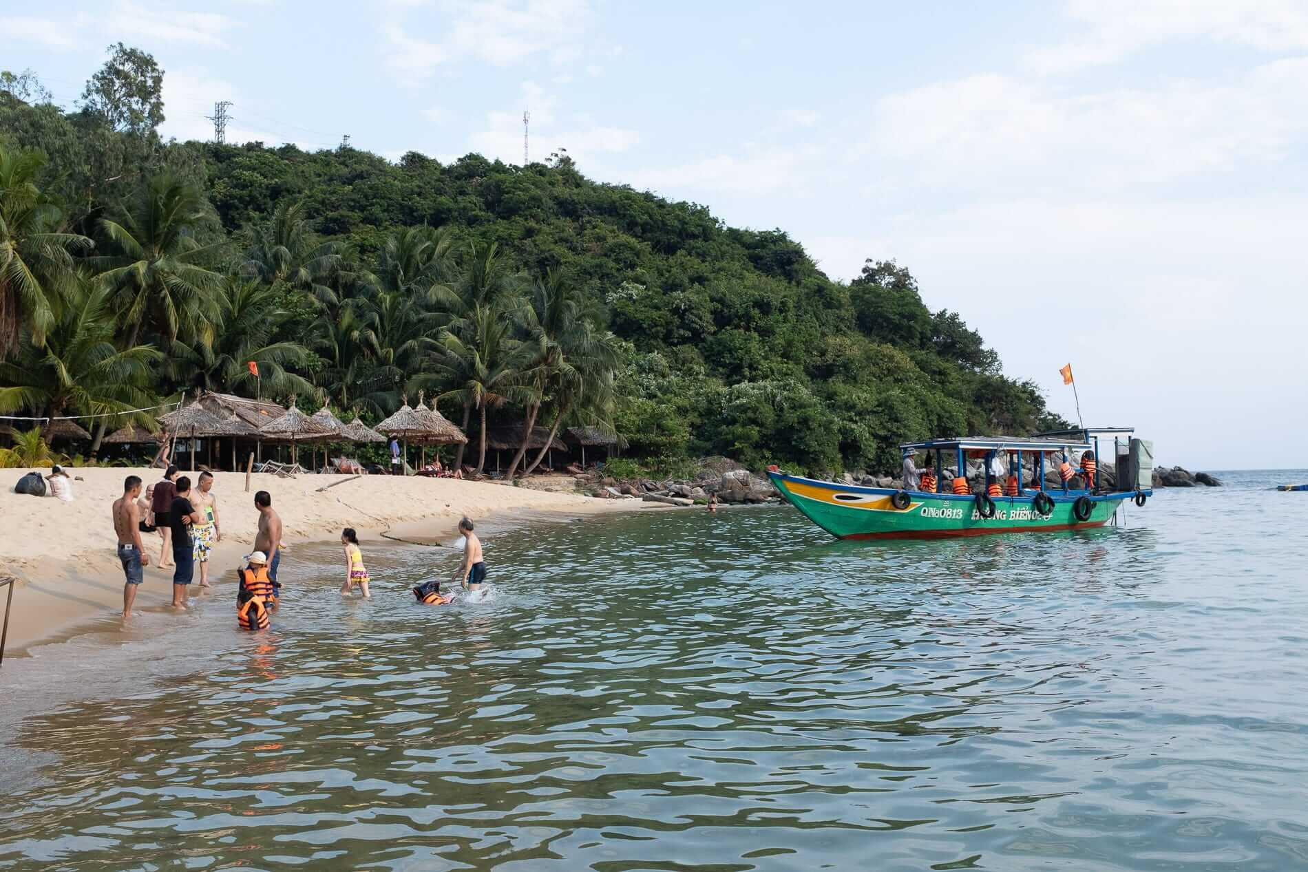 Family enjoying the beach at Cham Islands