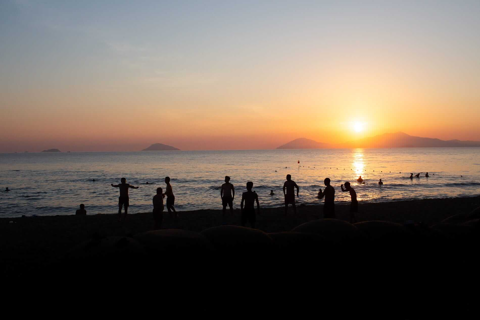 Cua Dai Beach with tourists at sunrise