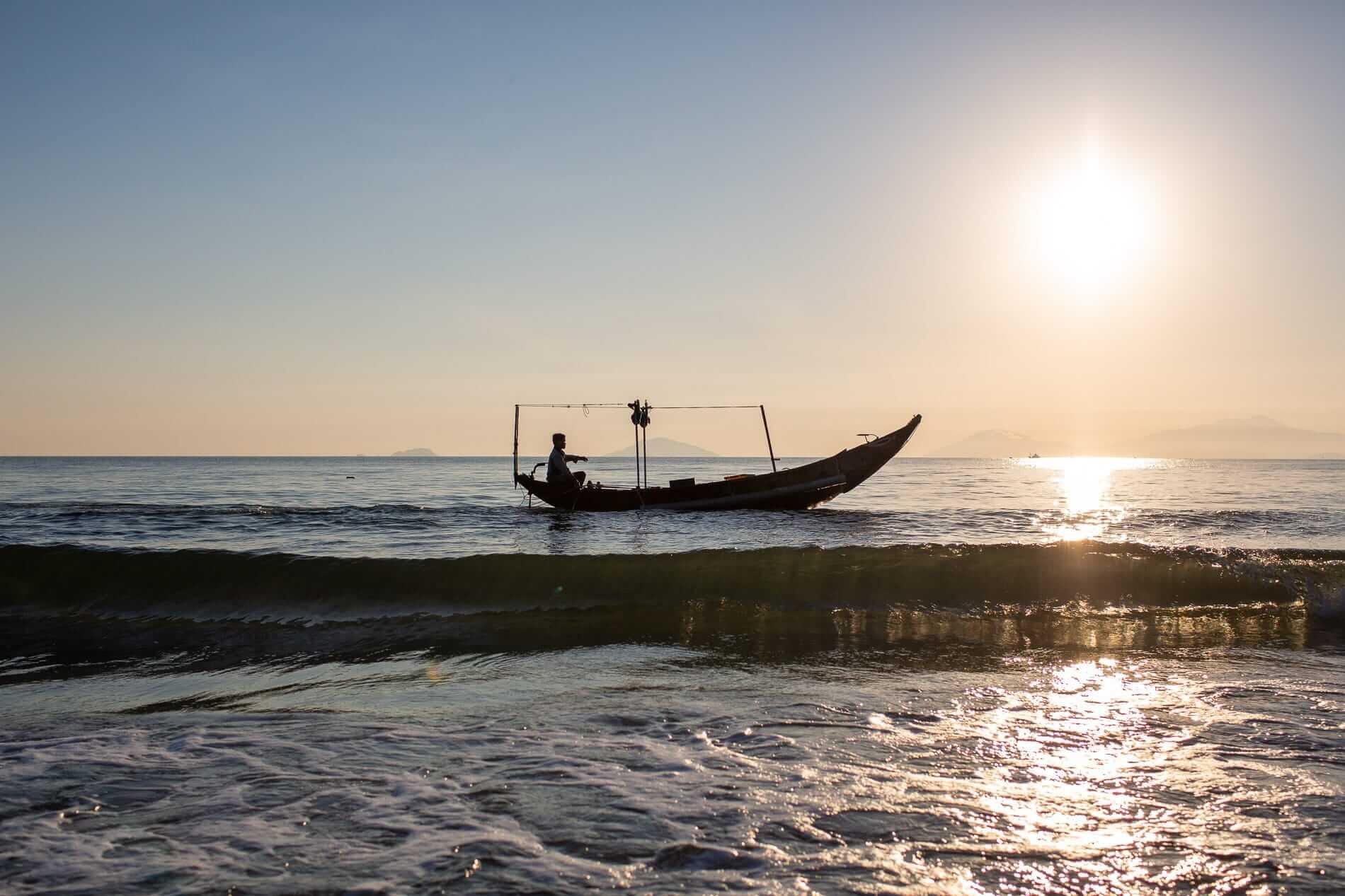 A fisherman busy fishing
