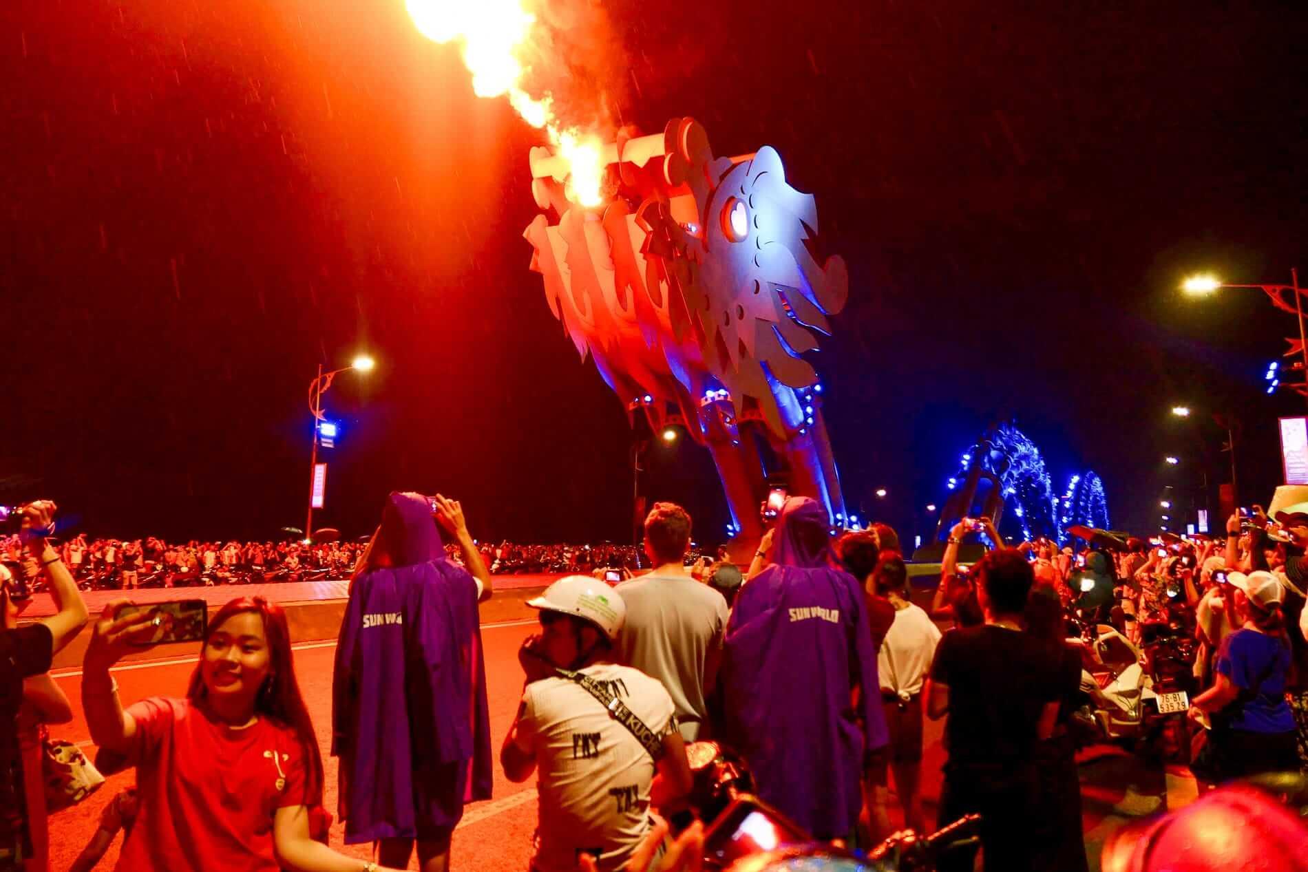 The Dragon Bridge breathing fire at night