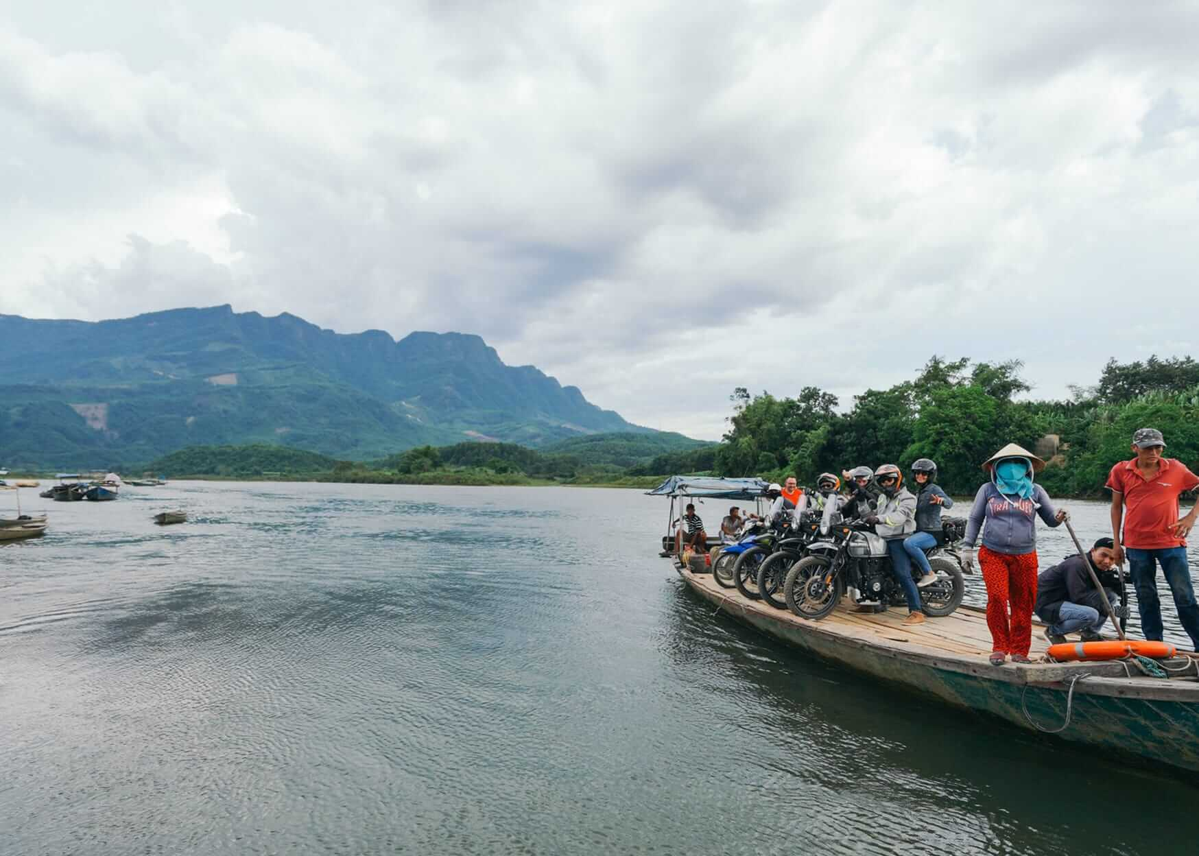 motorbike tour group on a ferry in Hoi An