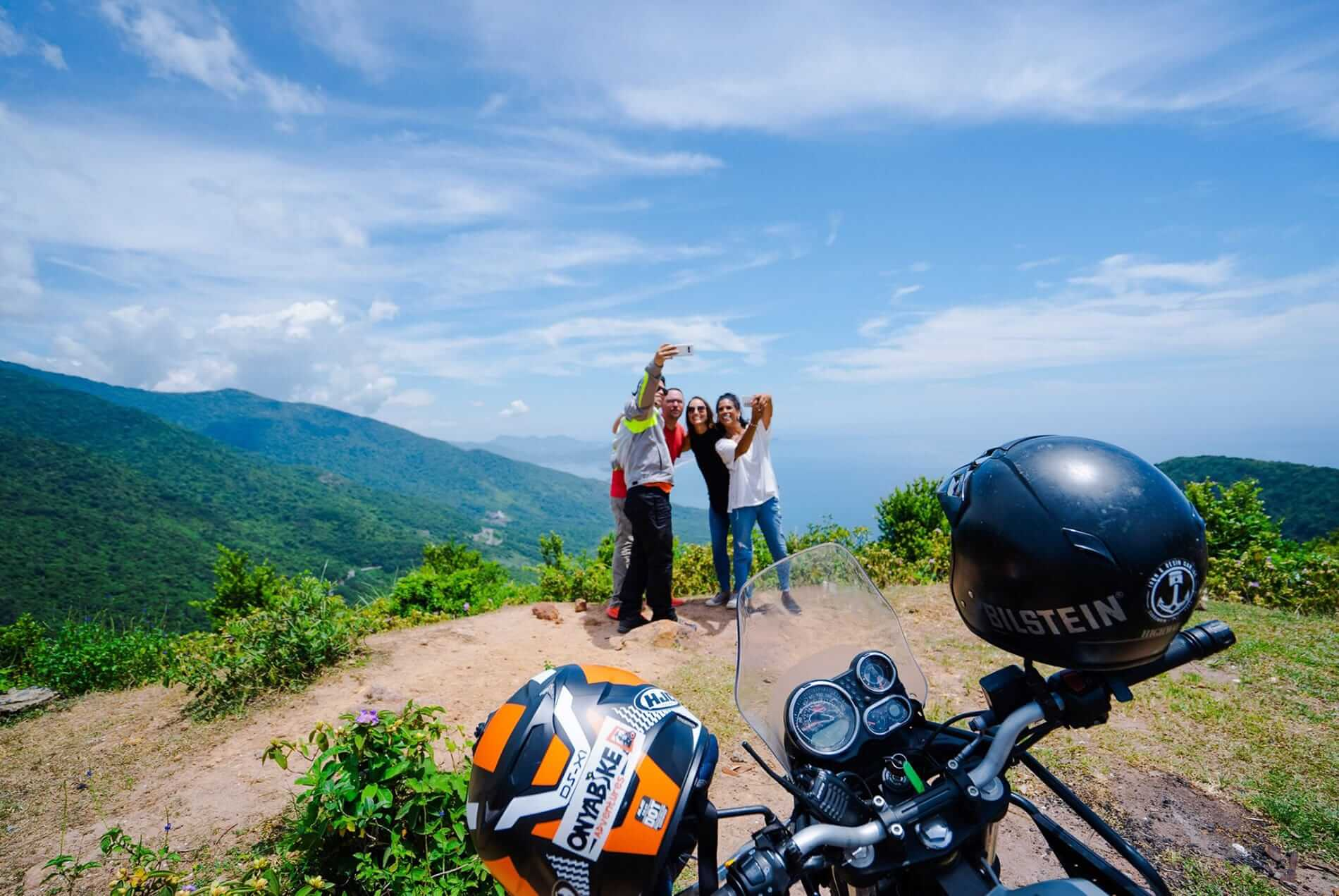 taking selfies at a motorbike tour in Hoi An