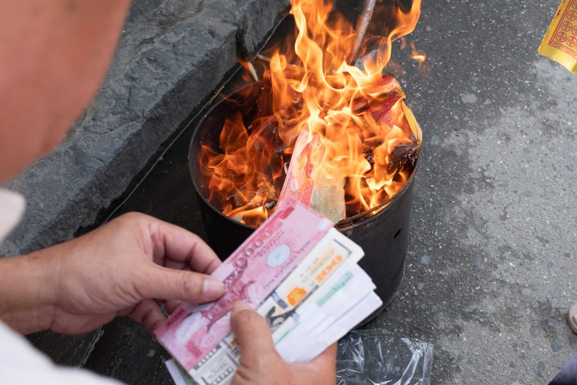 burning fake money at Tet