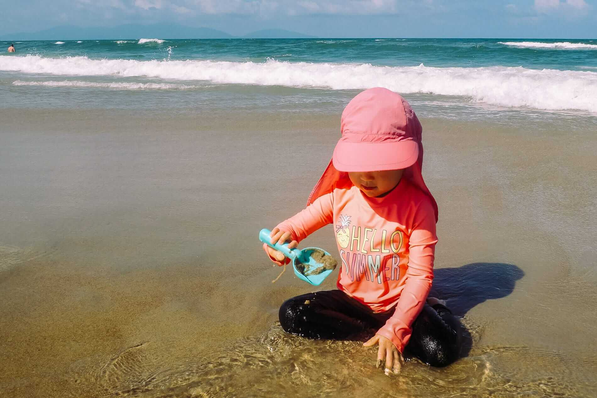 Child playing on the beach of An Bang