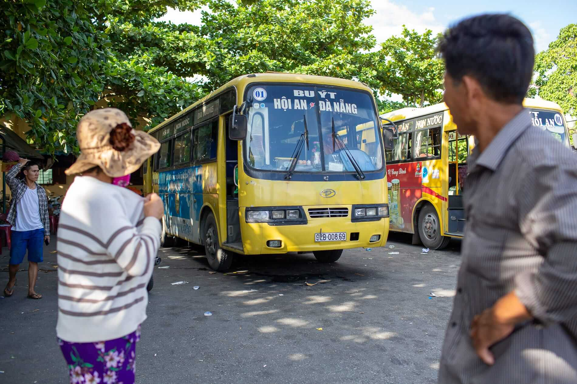 passengers check the Da Nang to Hoi An bus 1