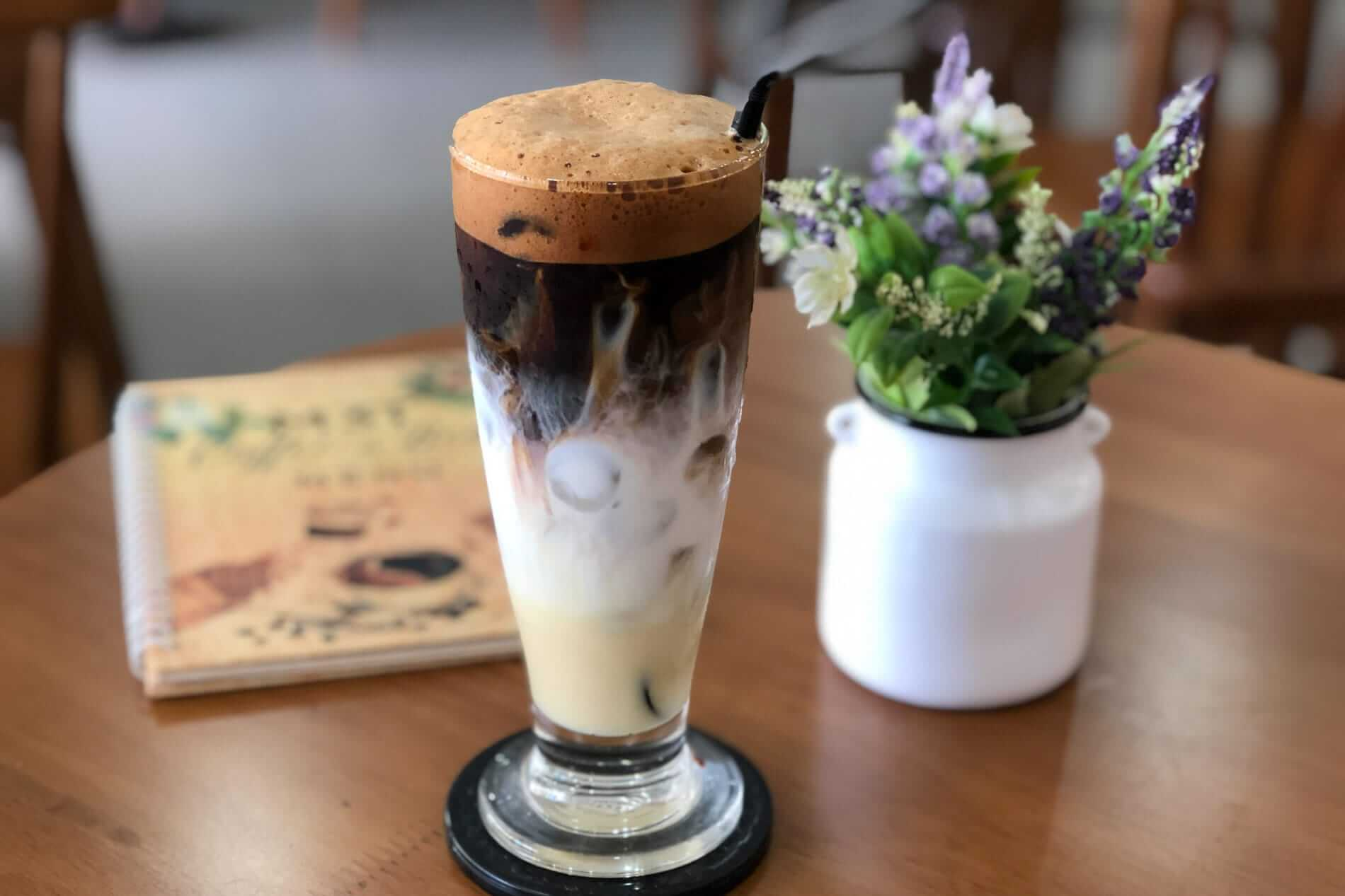 Three layered Vietnamese coffee with condensed milk in a cafe in Da Nang