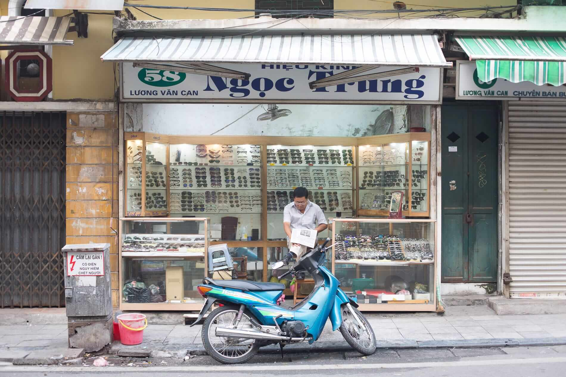 opening his shop in Hanoi