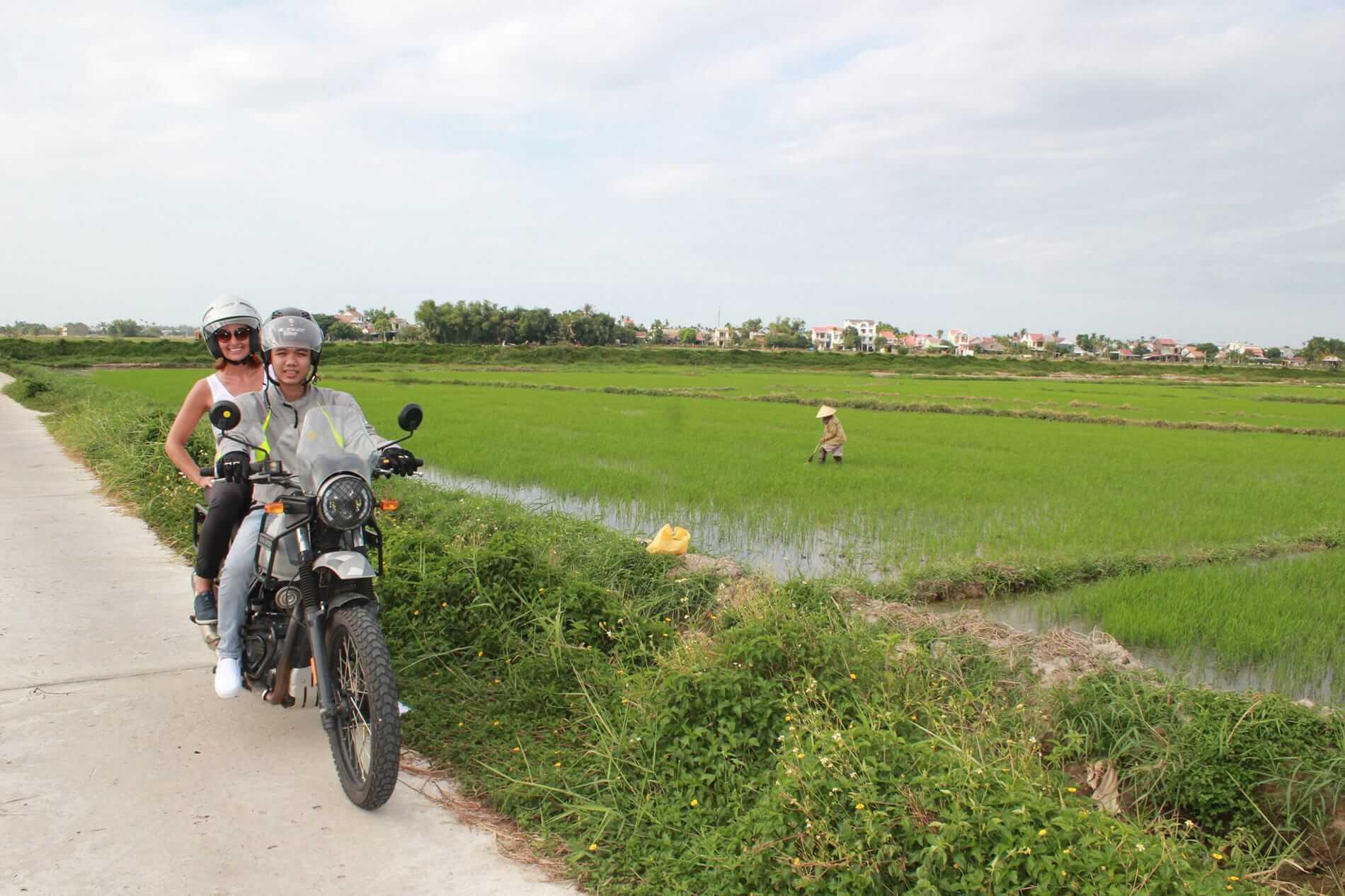 Couple tours Hoi An on a motorbike