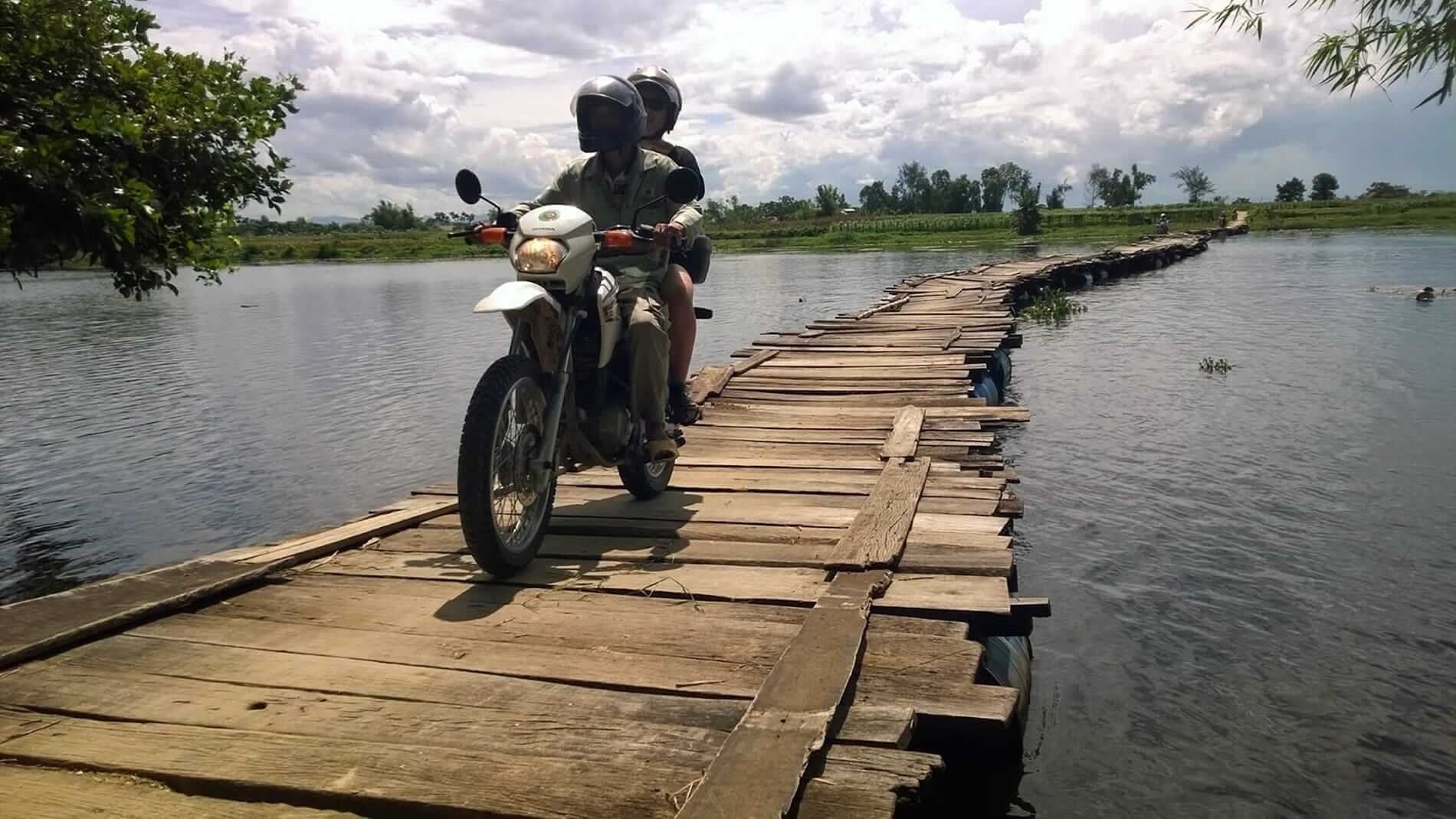 riding pillion on a temporary floating bridge