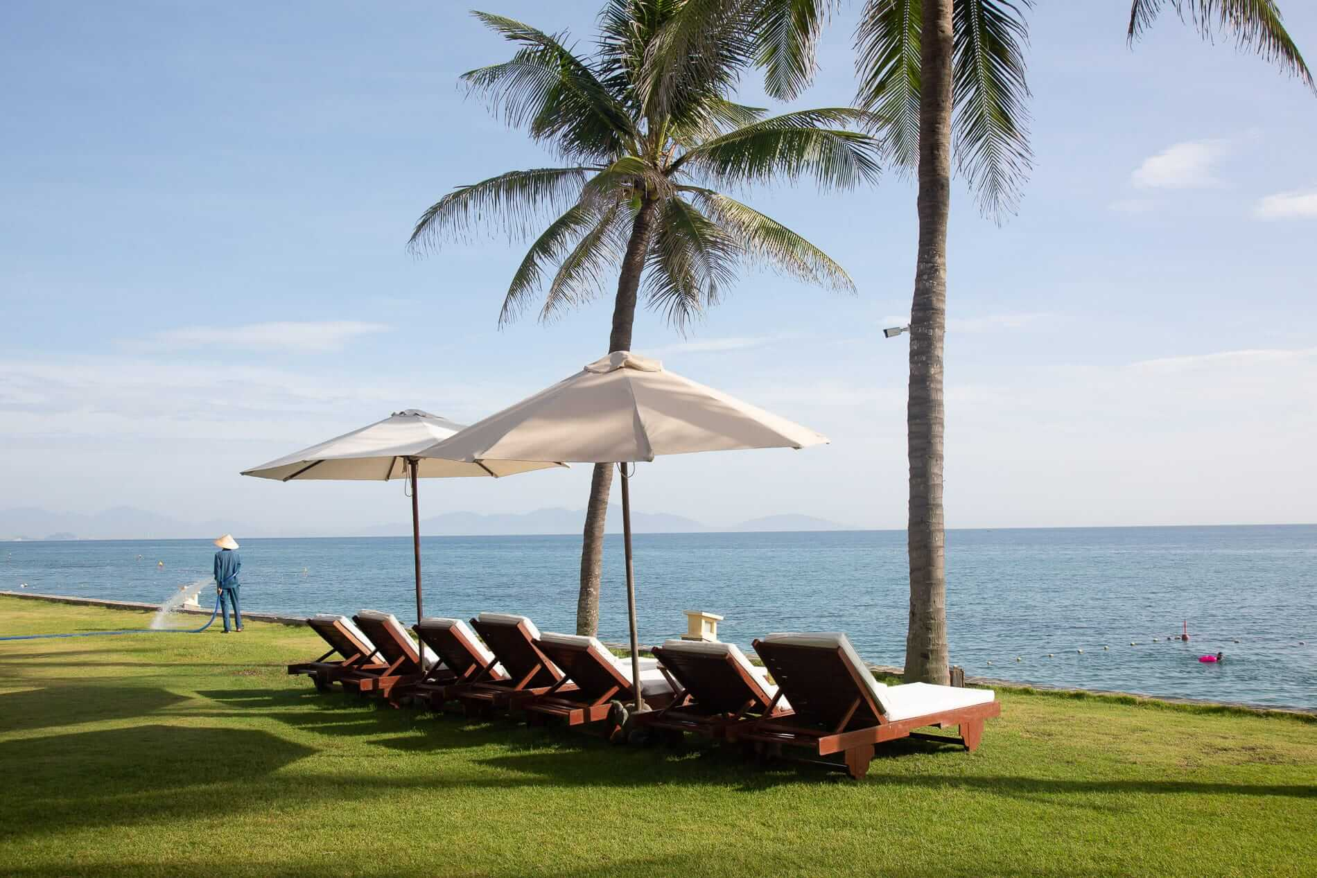 sun loungers located at the beachfront of Victoria Hoi An Resort