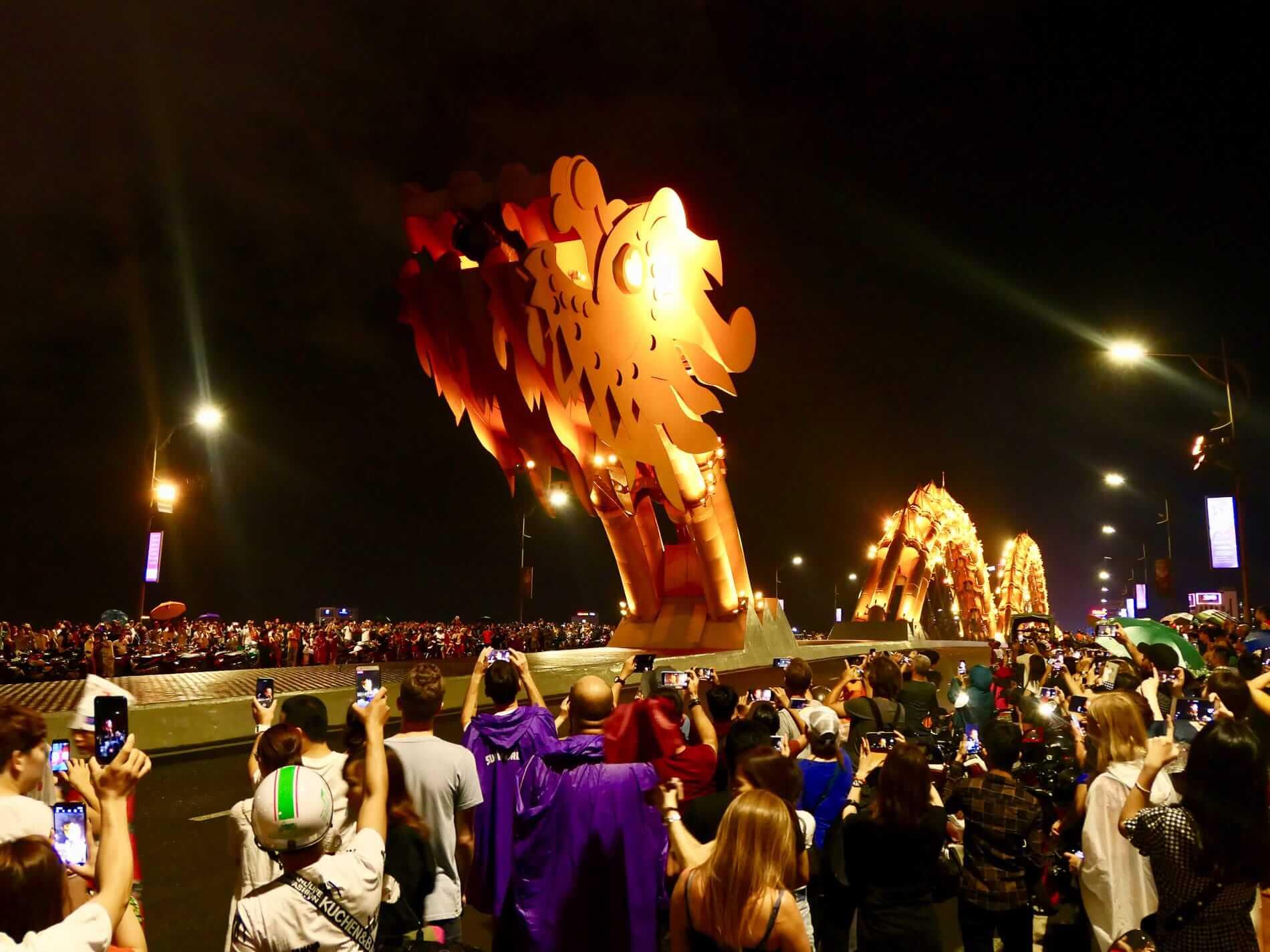 visitors watch the Dragon Bridge fire show