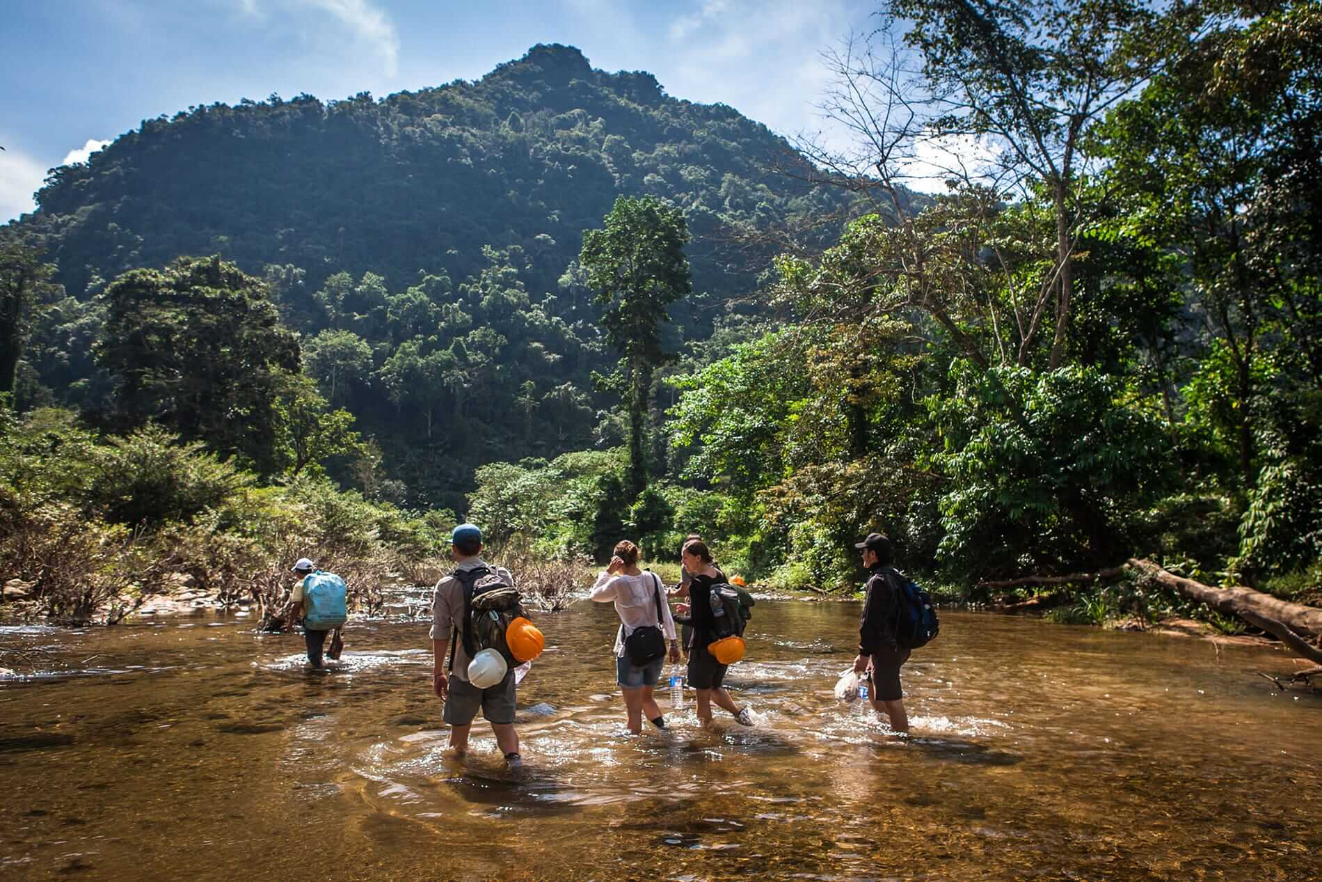 explorers trek through Ke Bang National Park