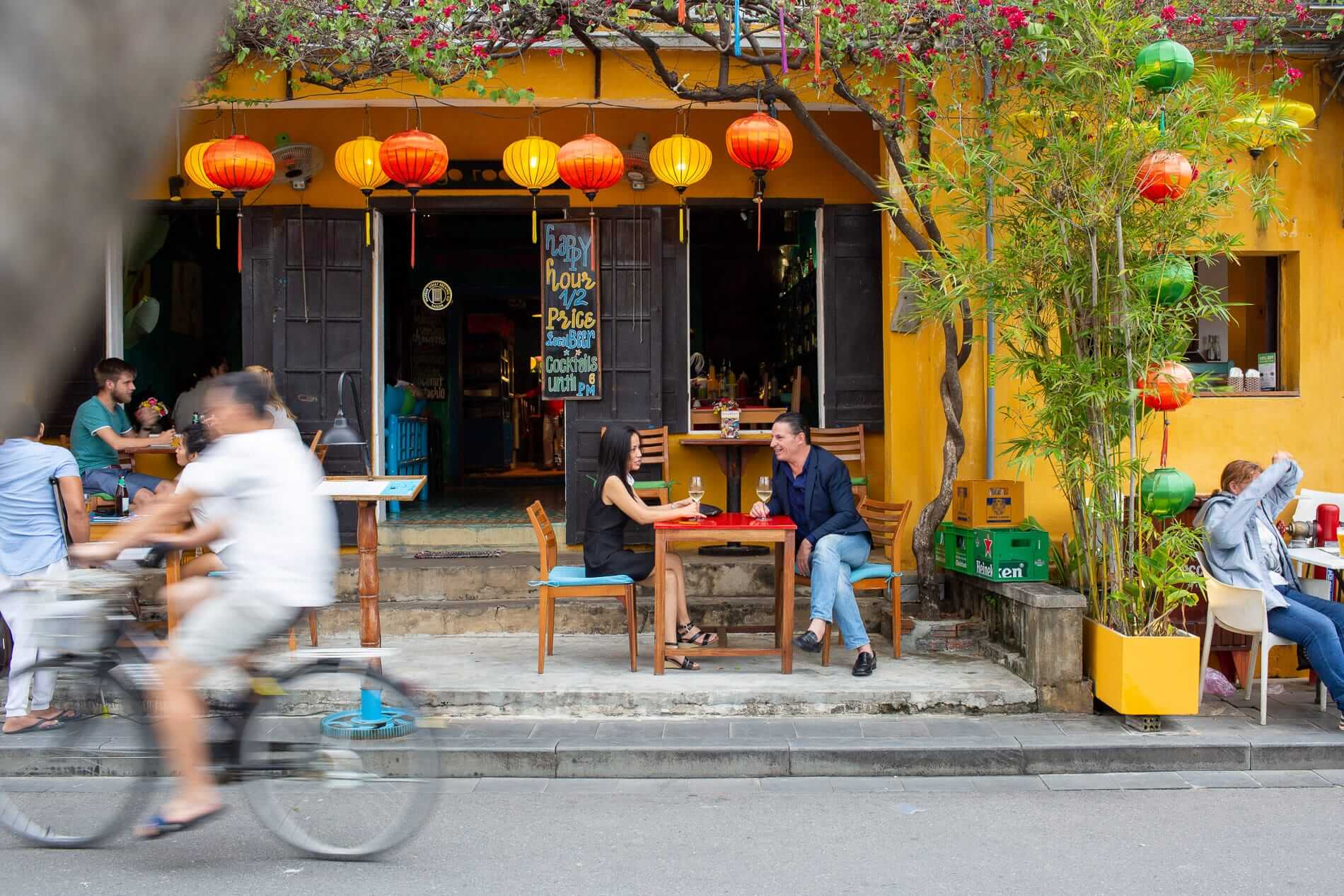 Bicycle rides past Hoi An restaurant